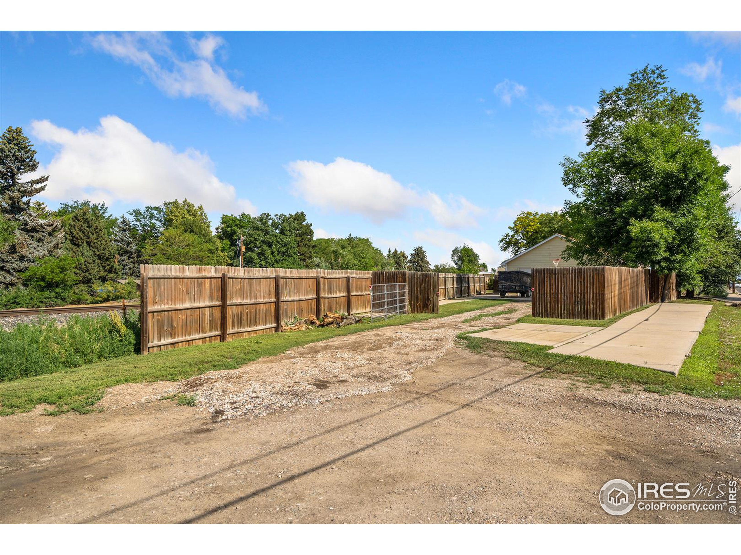 TONS of land right in the middle of town!  Plenty of room for an RV, toys, trailers, and more.