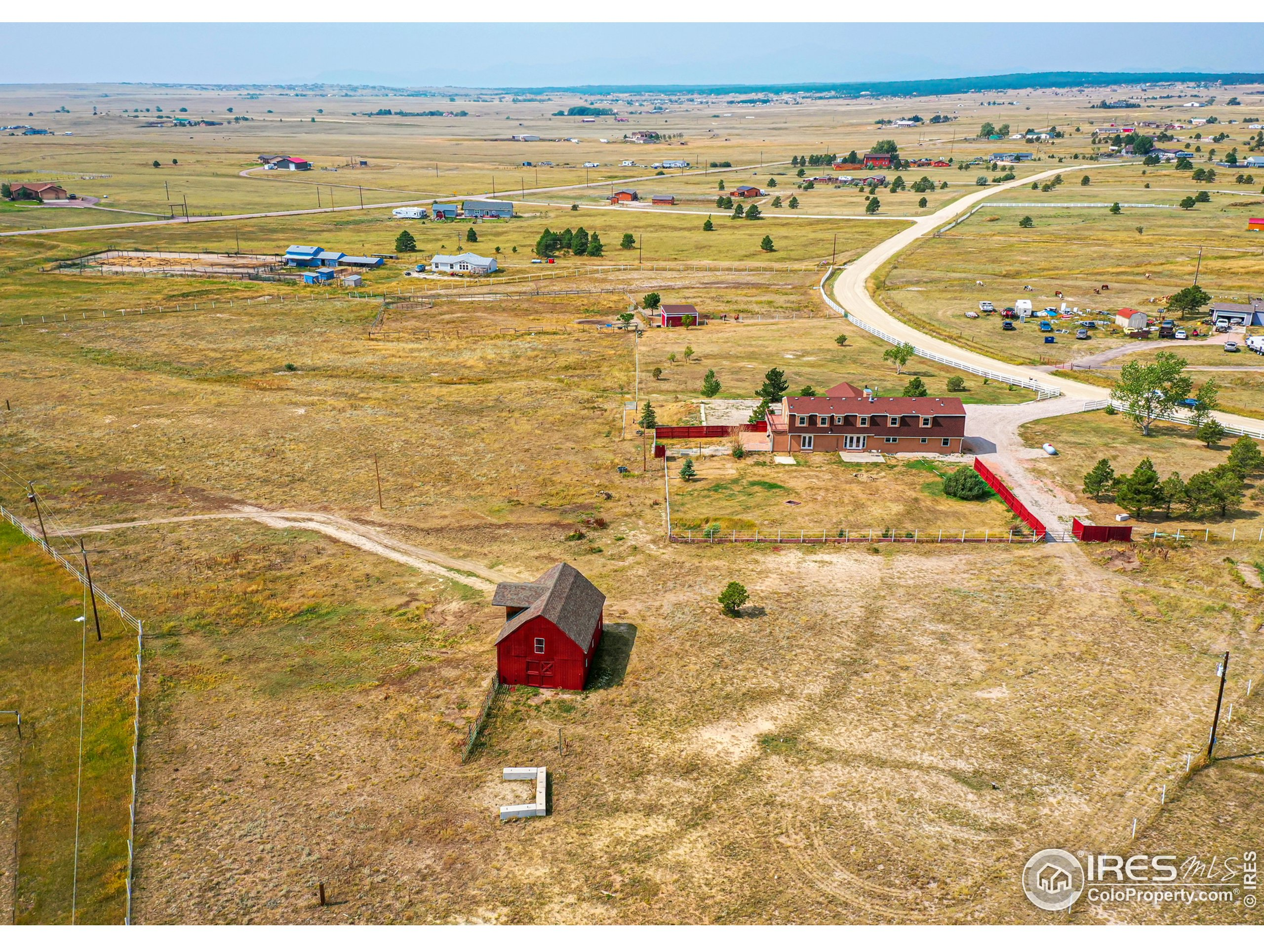 A view of the back of the property looking Southwest toward the front of the property. Your barn and loafing shed can be spotted here too.