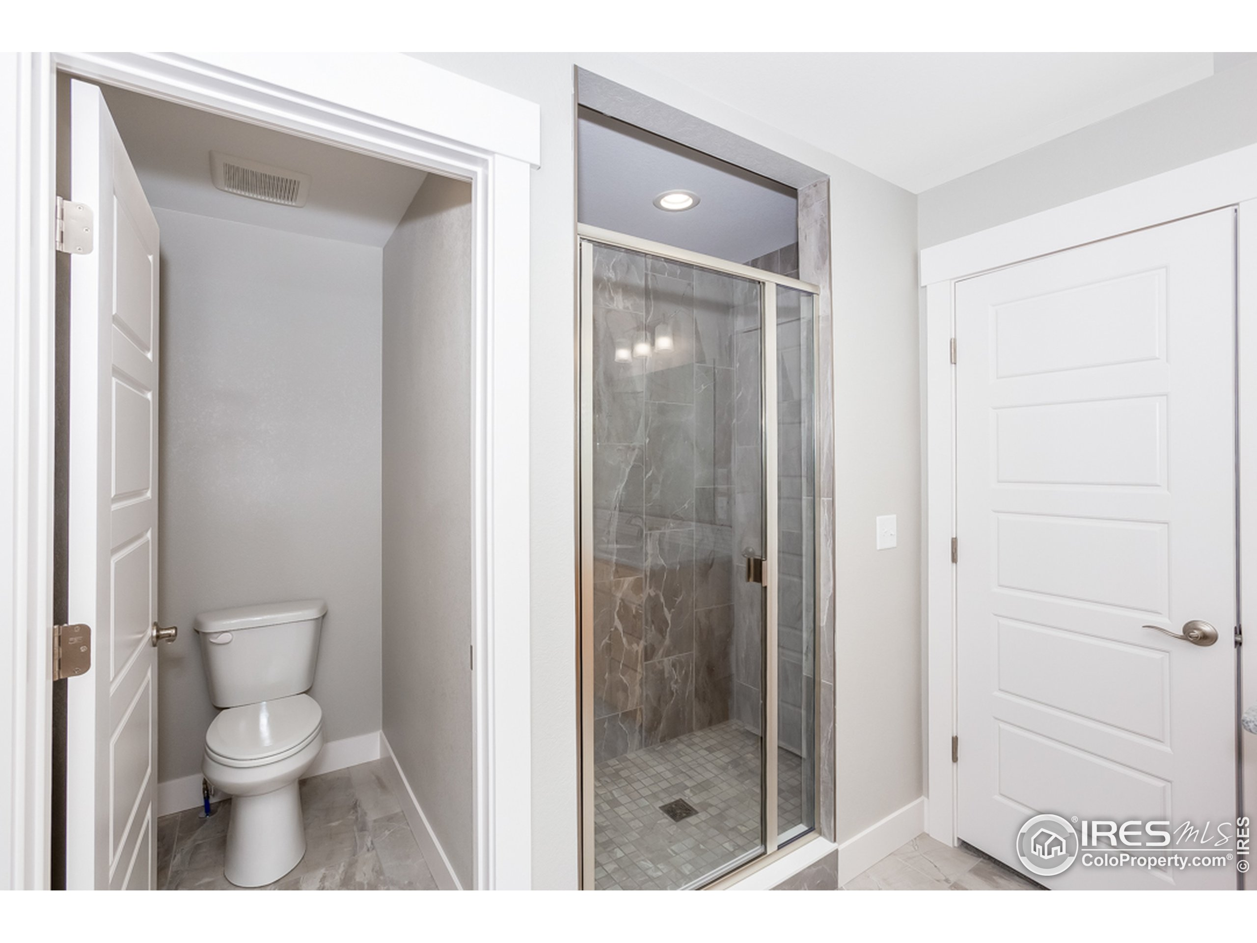 A private water closet and stall shower