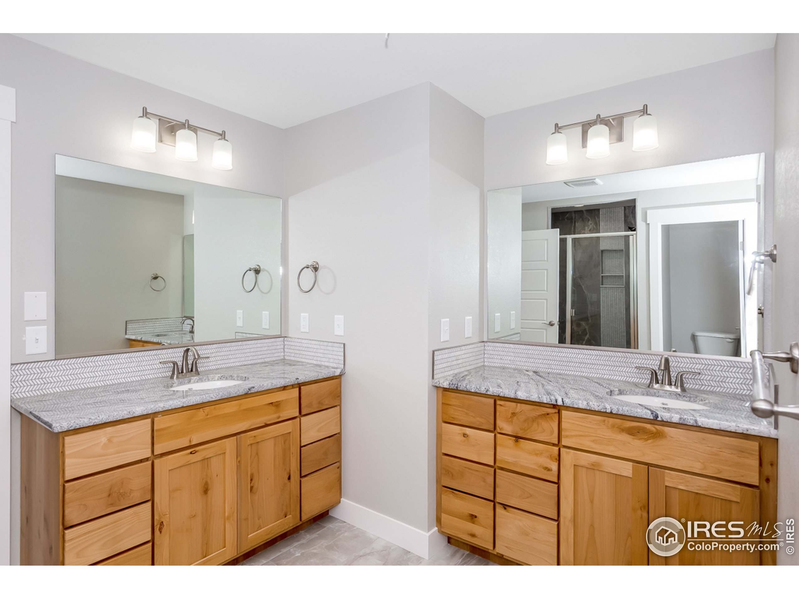 Double vanity in the primary bath can make mornings less hectic