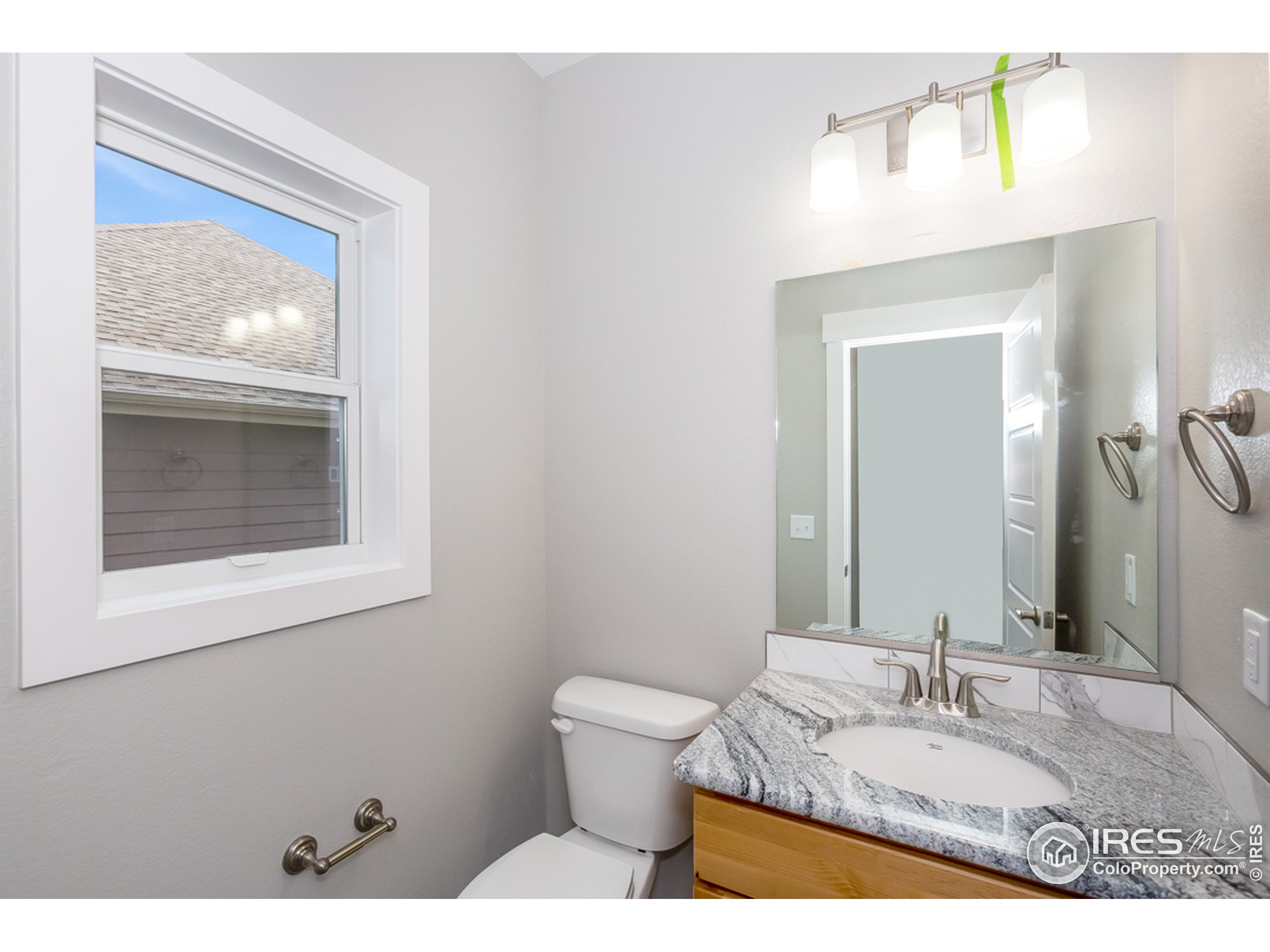 Powder bath conveniently located off the living room/entry area