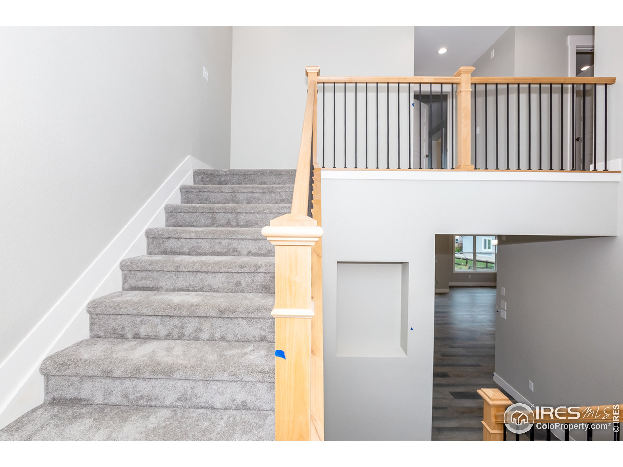 Stylish wrought iron bannister leads to the upper floor