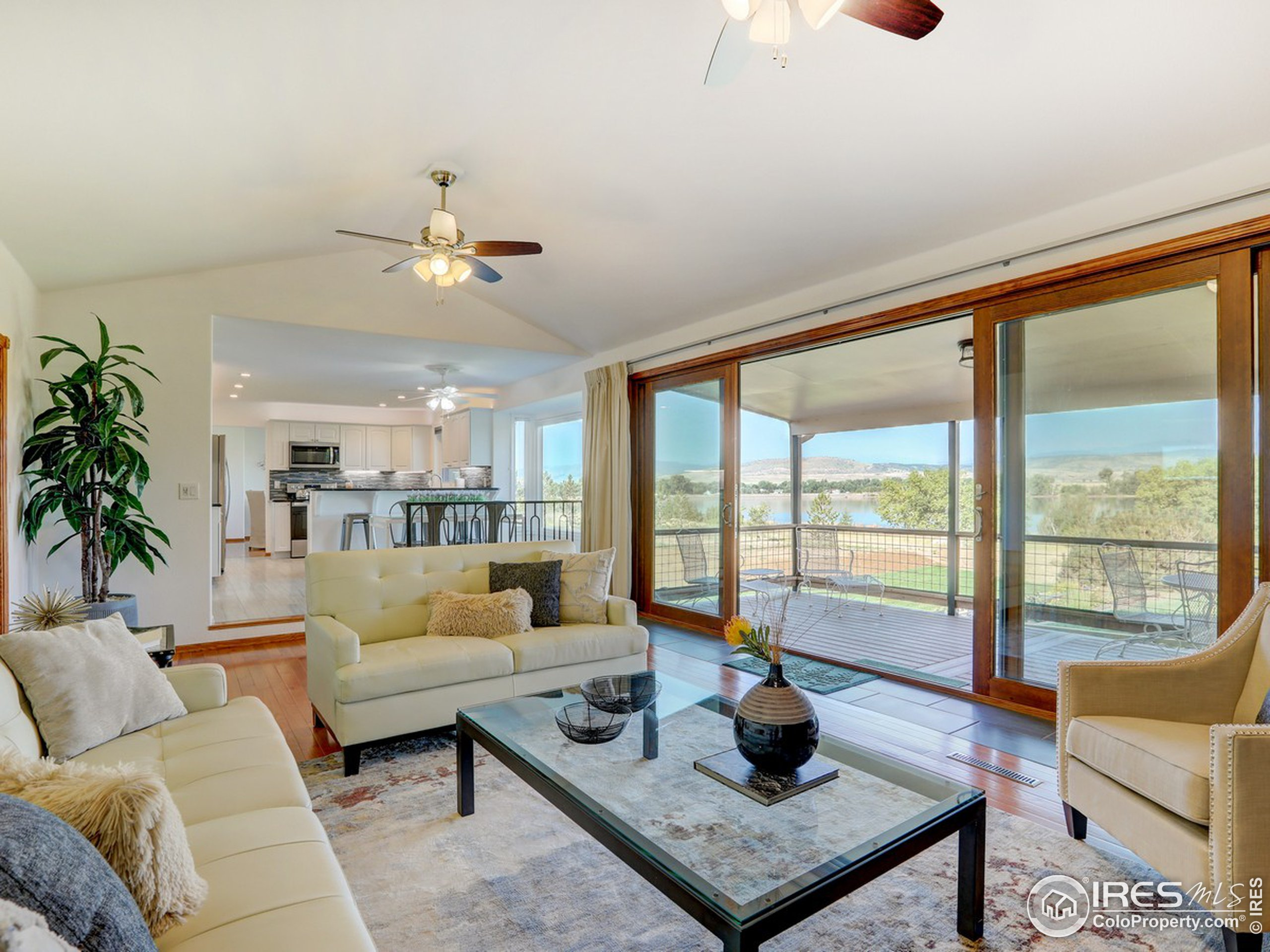 Spacious living room opens to covered deck.
