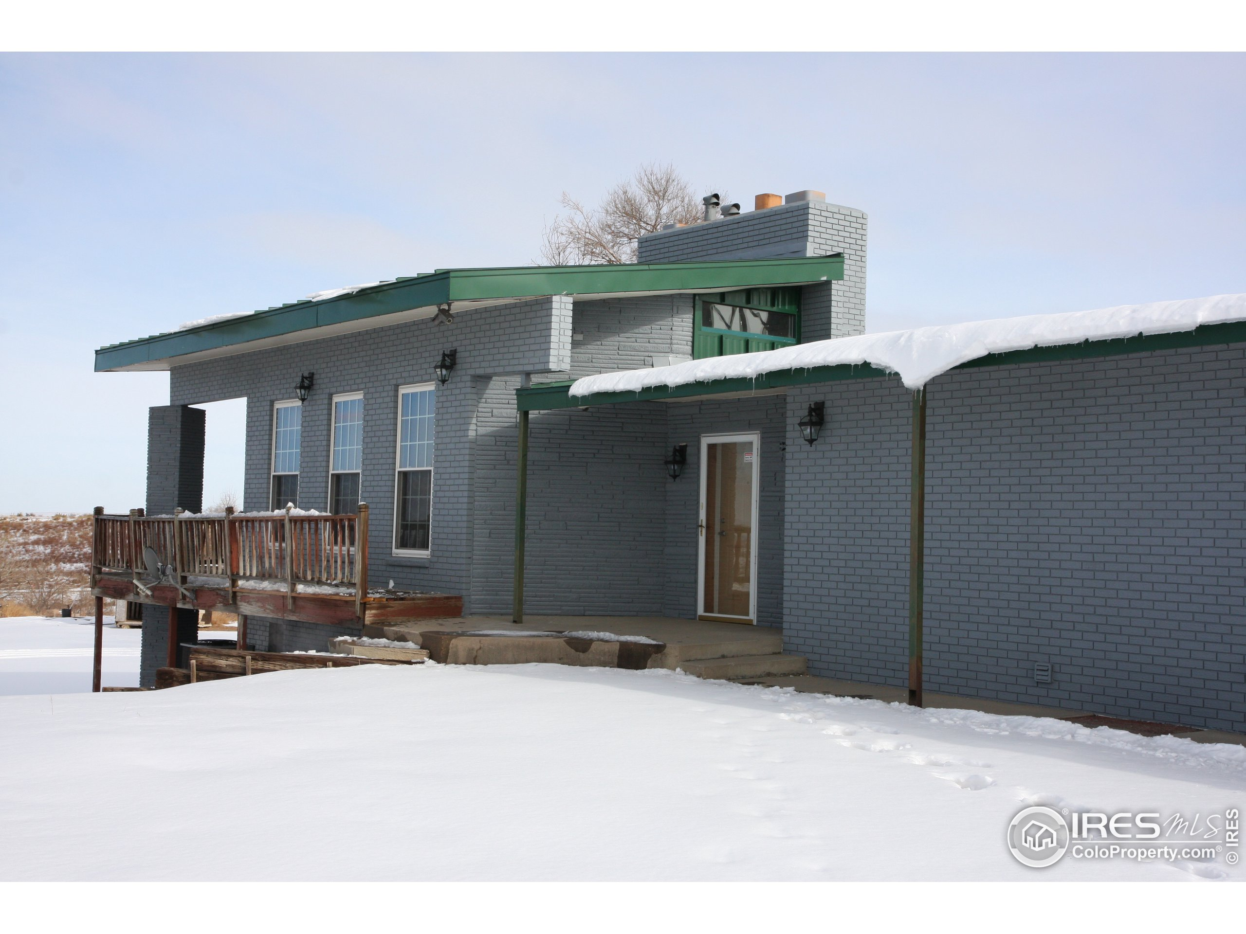 Remodeled Kitchen with all wood cabinets and concrete countertops.