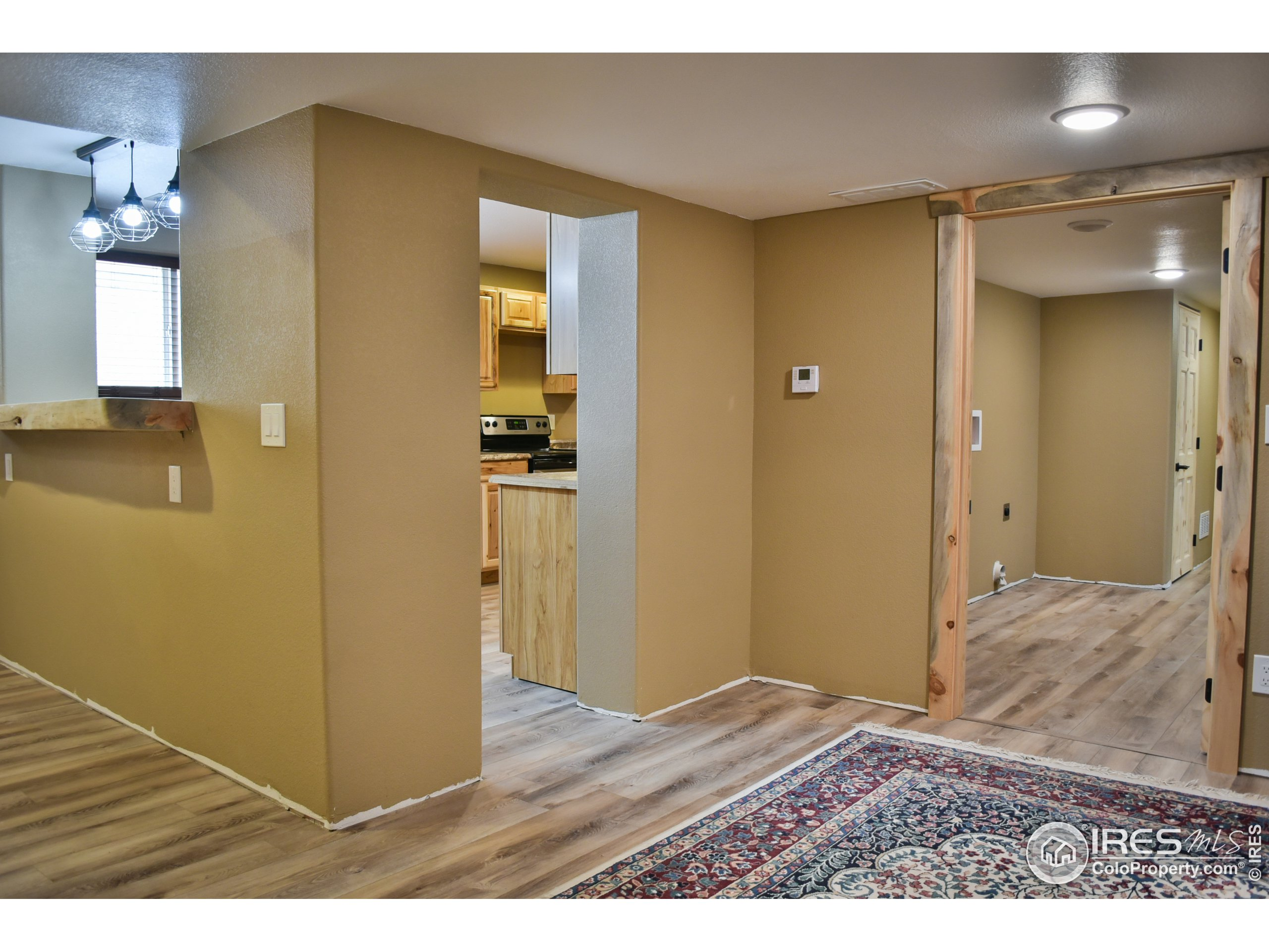 Updated Basement Kitchen with view to dining nook (or foosball - whatever floats your boat!)