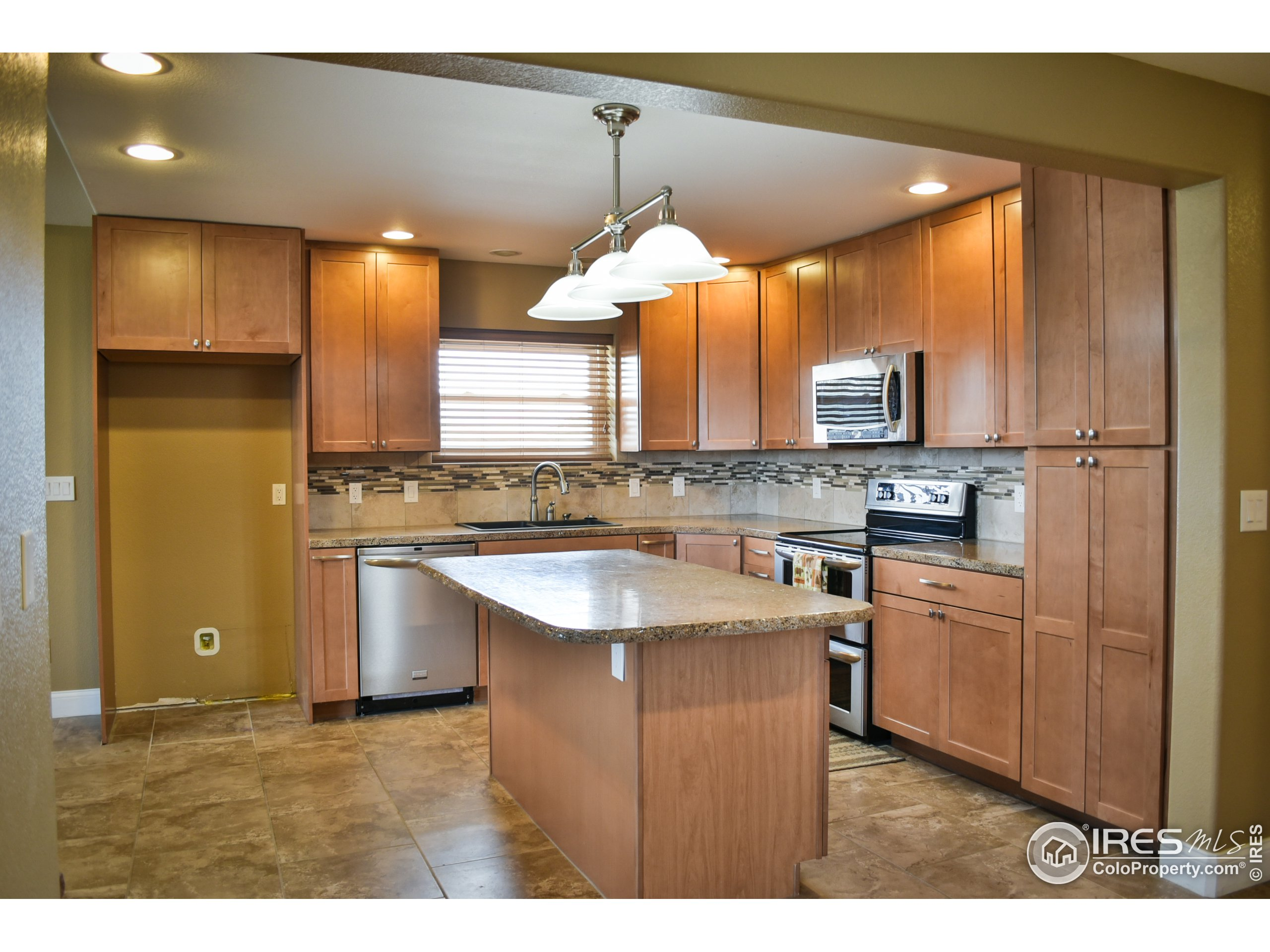 Remodeled Kitchen, seen from hearth room/ dining area.