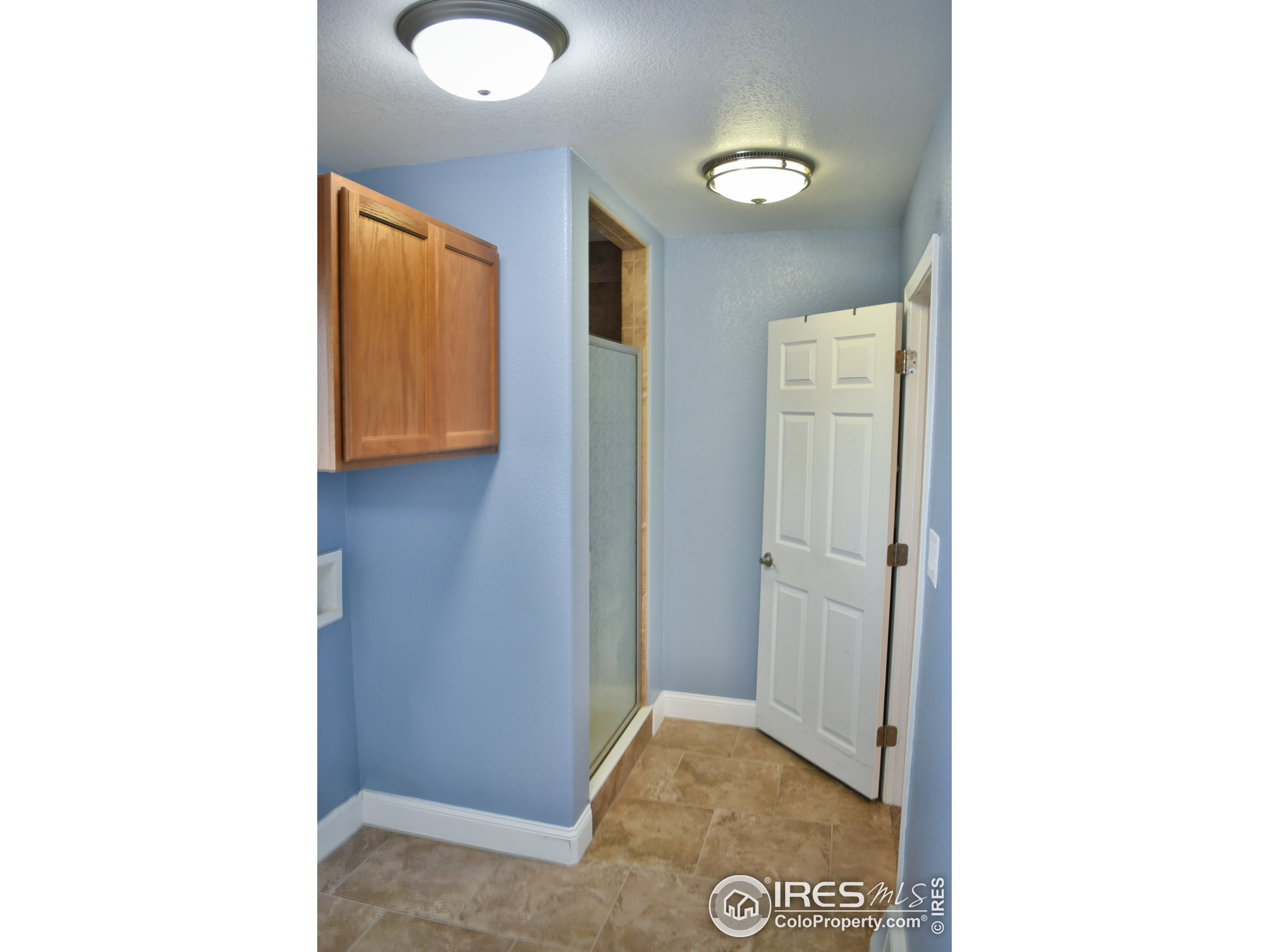 Hallway with view to Master Bedroom all the way at the end.