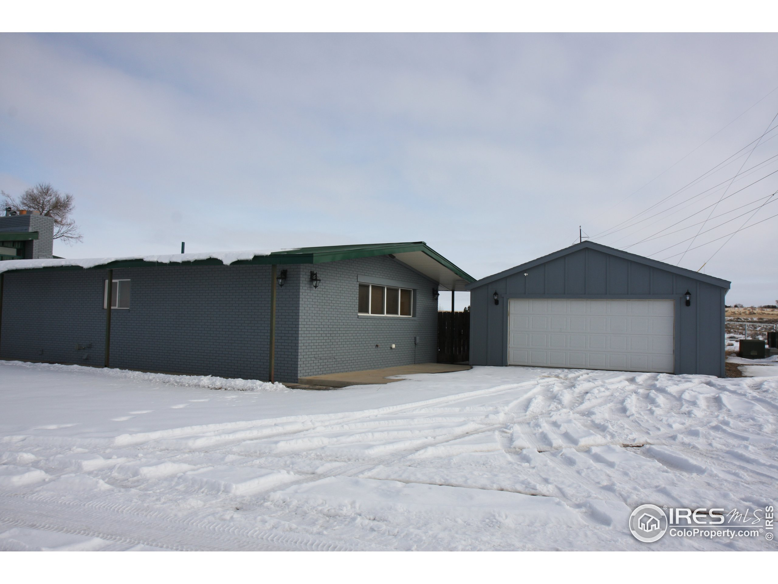 Aerial Photo 3. The garage and workshop stay - all other trailers and sheds will be removed.