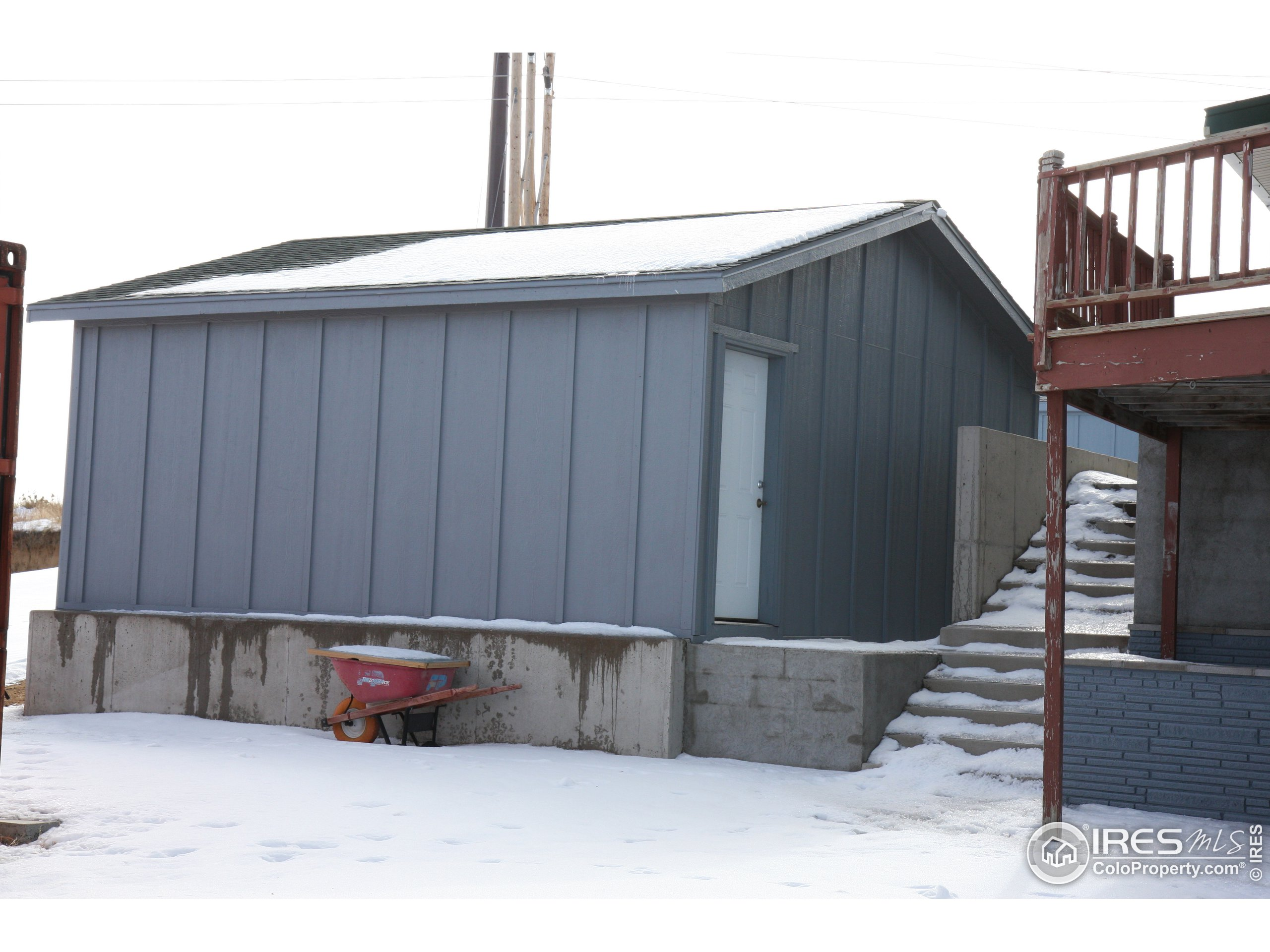 Aerial Photo 2.  The garage and workshop stay - all other trailers and sheds will be removed.