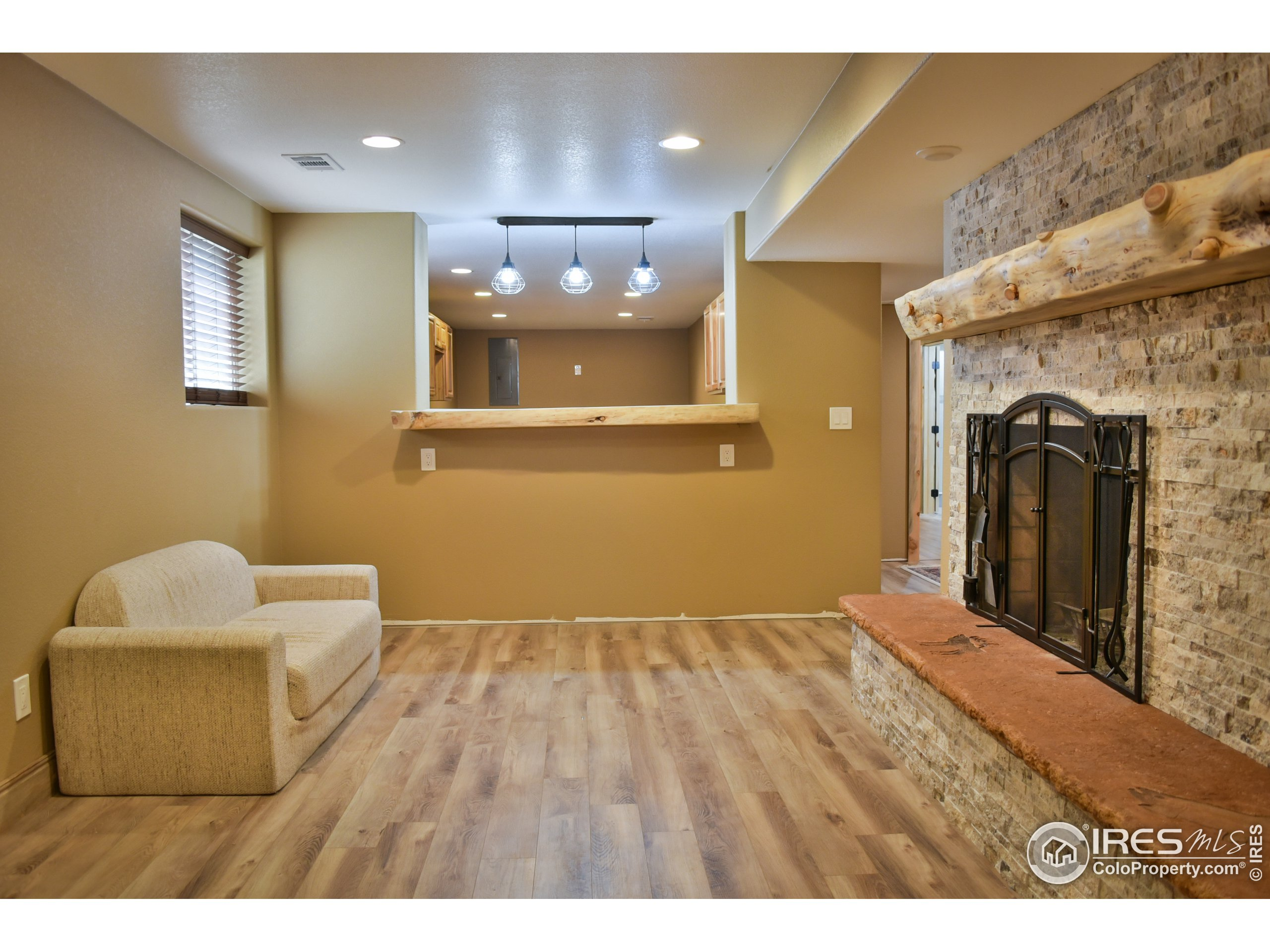 Basement hearth room with view to kitchen.