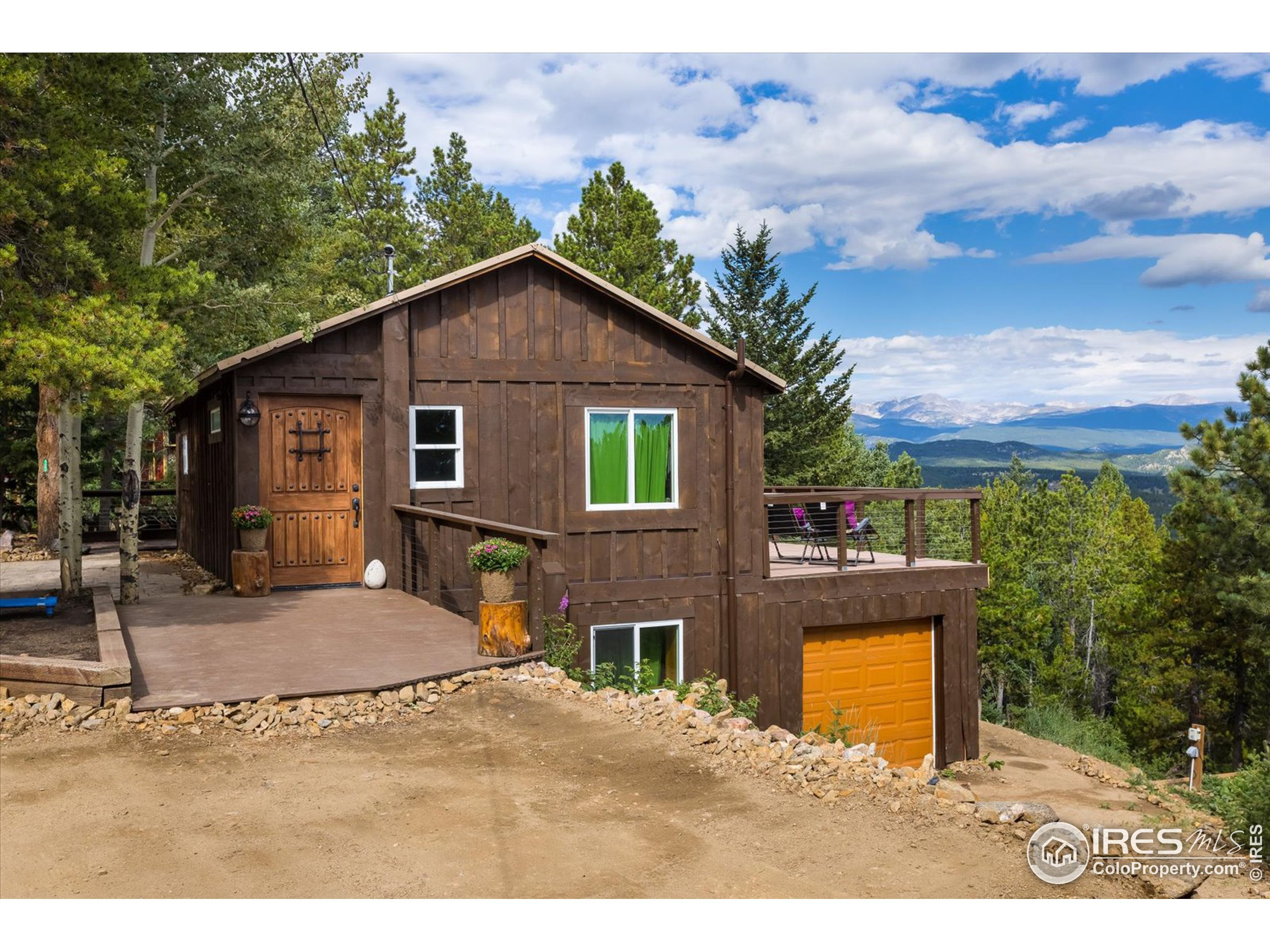 Stunning luxurious mtn home has been completely & thoughtfully remodeled w/ designer finishes, where every inch of space is used effectively, including the spacious back deck to enjoy jaw dropping views! Location doesn't get any better w/unobstructed snowcapped mtn views, close access to Nat'l Forest, trails & Echo Rock out your backdoor.  Open flr plan w/ built-in Arhaus kitchen, Bosch fridge, wd stove, beautiful wd flrs & locally milled wd ceilings. Walk-out lower lev includes mstr bdrm w/ built-ins, lux 5-pc bath w/ lg soaking tub, glass enclosed shower, 2 sink areas, beautiful stone/tile work. Laundry & access to 1car garage (could be converted to 2nd bedrm). Tranquil & serene yard lives lg w/new landscaping including 52000 lbs of stone, flowerbeds, patio, privacy fences, walkways leading to many seating areas. New ext railings, retaining walls. High speed internet & relaxing atmosphere allow for an ideal work & play from home situation! Easy commute Boulder/Denver, Eldora Ski Area