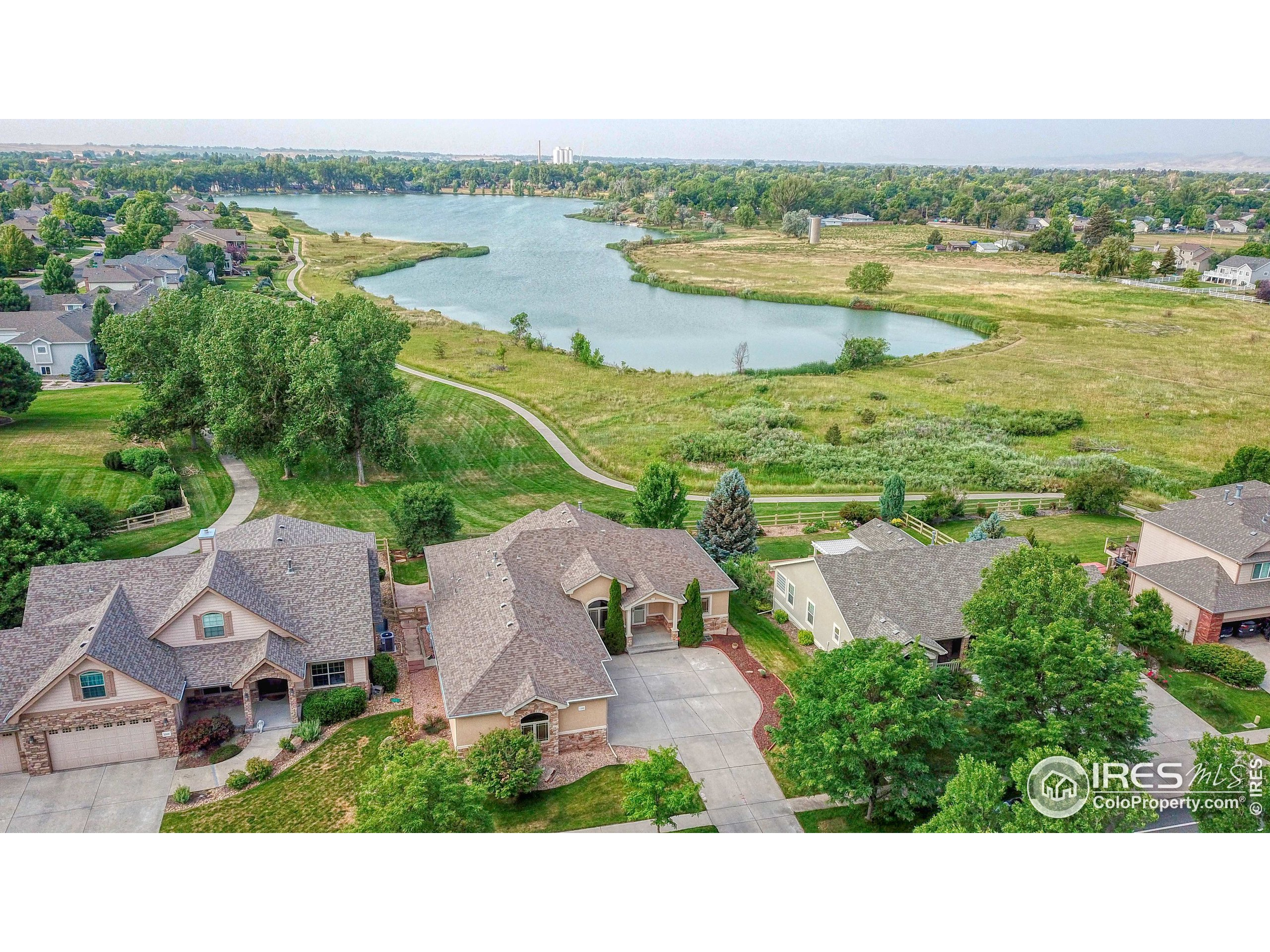 Great Opportunity to enjoy Mountain and Lake Views right here in Northern Colorado! The Seven Lakes Neighborhood is a very desirable community backing to private open space and the non-motorized lake. Enjoy paddle boarding, kayaking and more! Great walking and biking trails! Spacious open floor plan ranch home a large 0.24 acre fenced lot with hickory floors, granite countertops, gas stove, double ovens, 3 sided fireplace, dining room/study and amazing views! Immense oversized garage with so much storage! Daylight basement and an amazing theatre room, as well as a huge rec room.