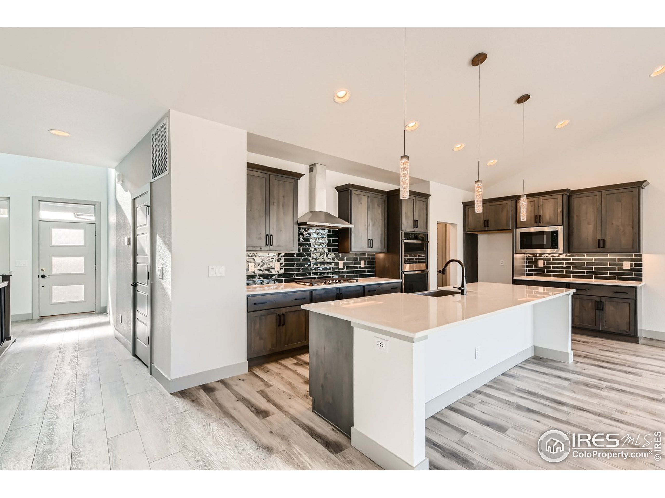 Foyer - All photos are of a previously built home.