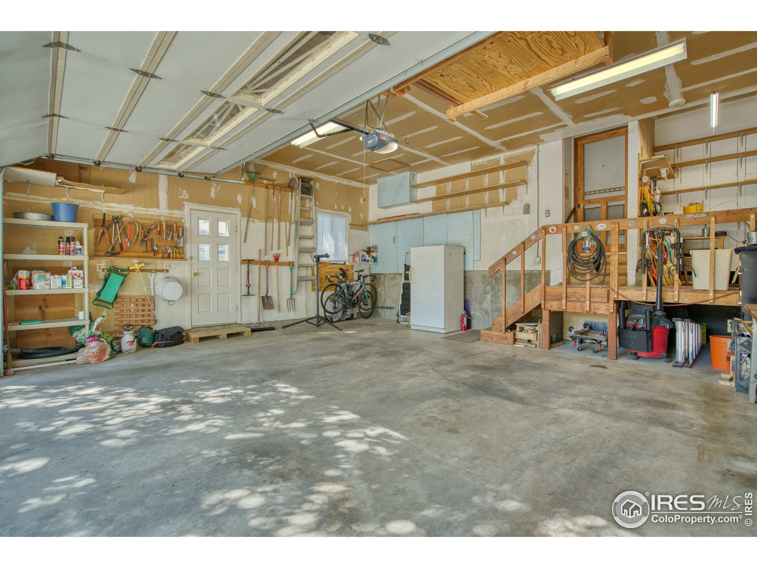Garage with Raised Workshop Area & 220 Outlet