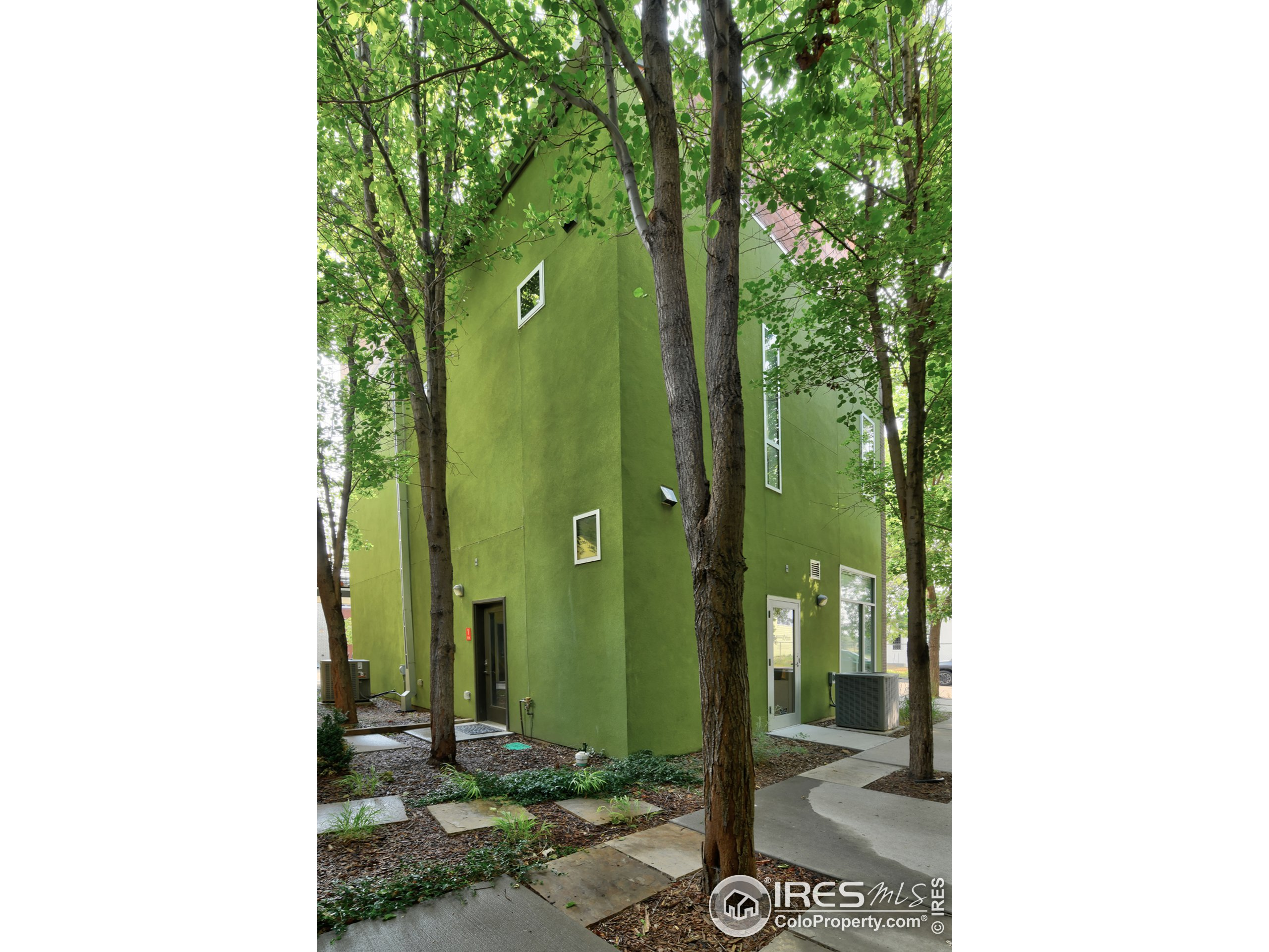 Mature Pear Trees & Professional landscaping greet you