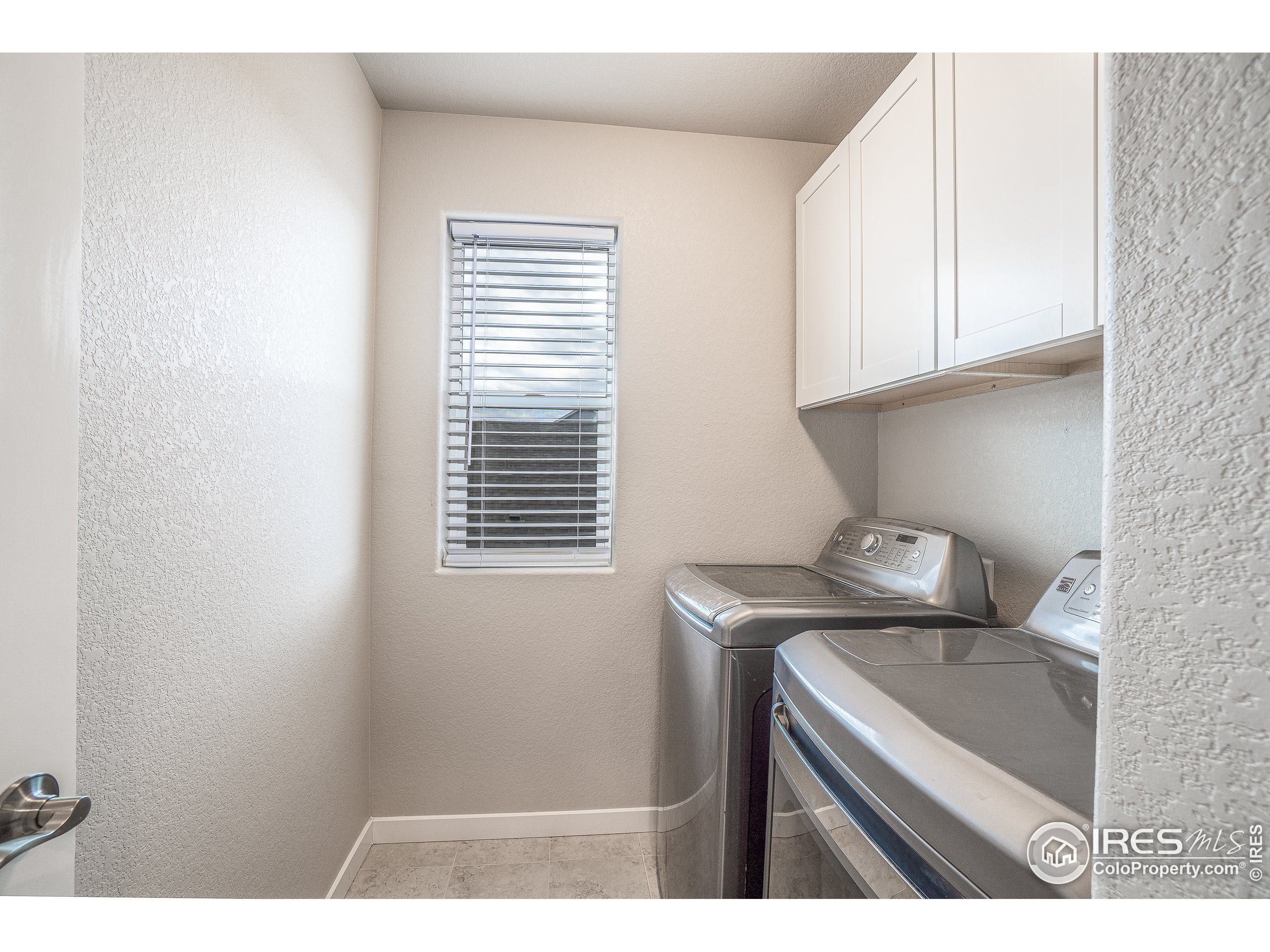 Laundry room with cabinets for storage