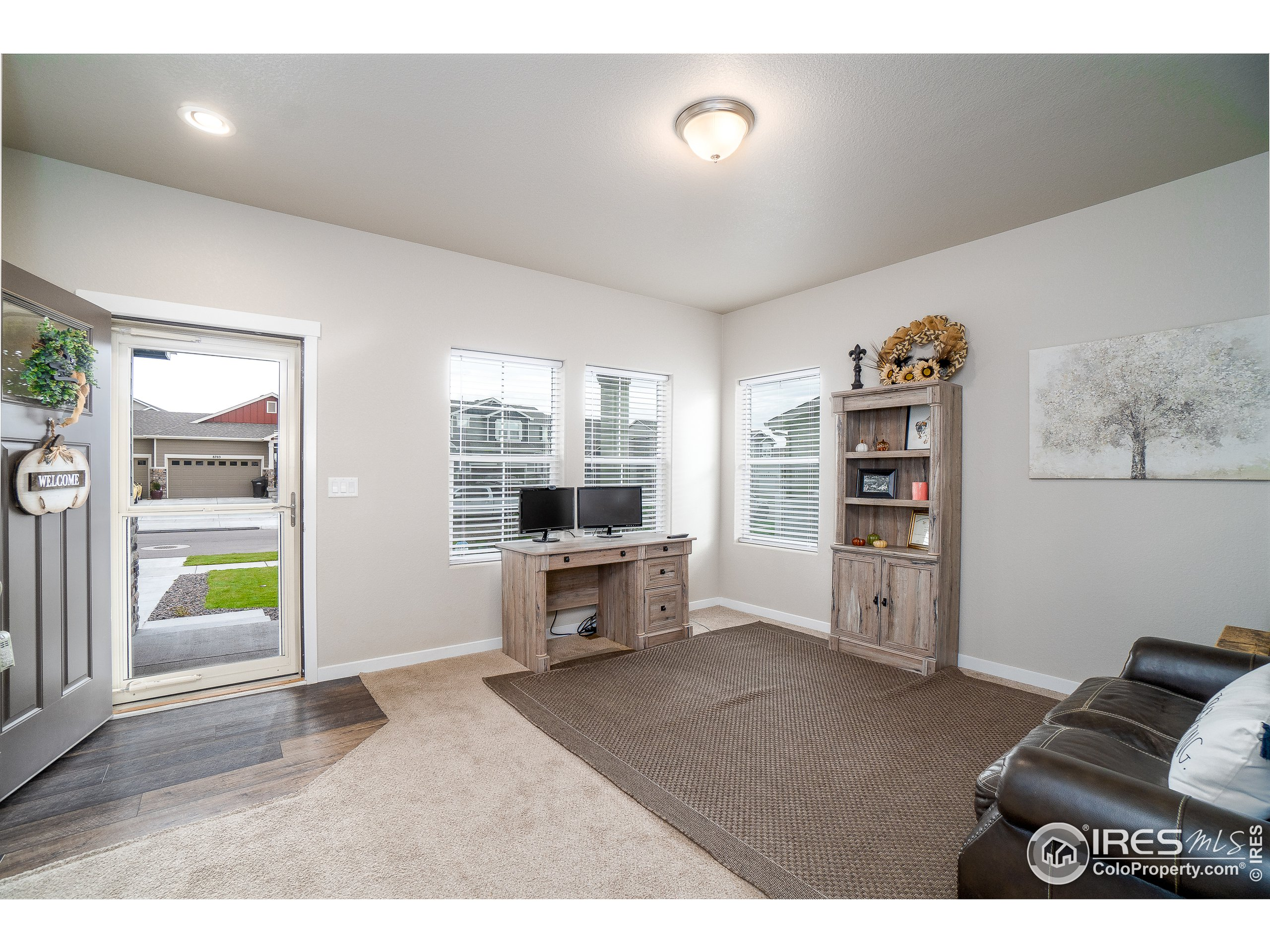Formal living area by front entry door
