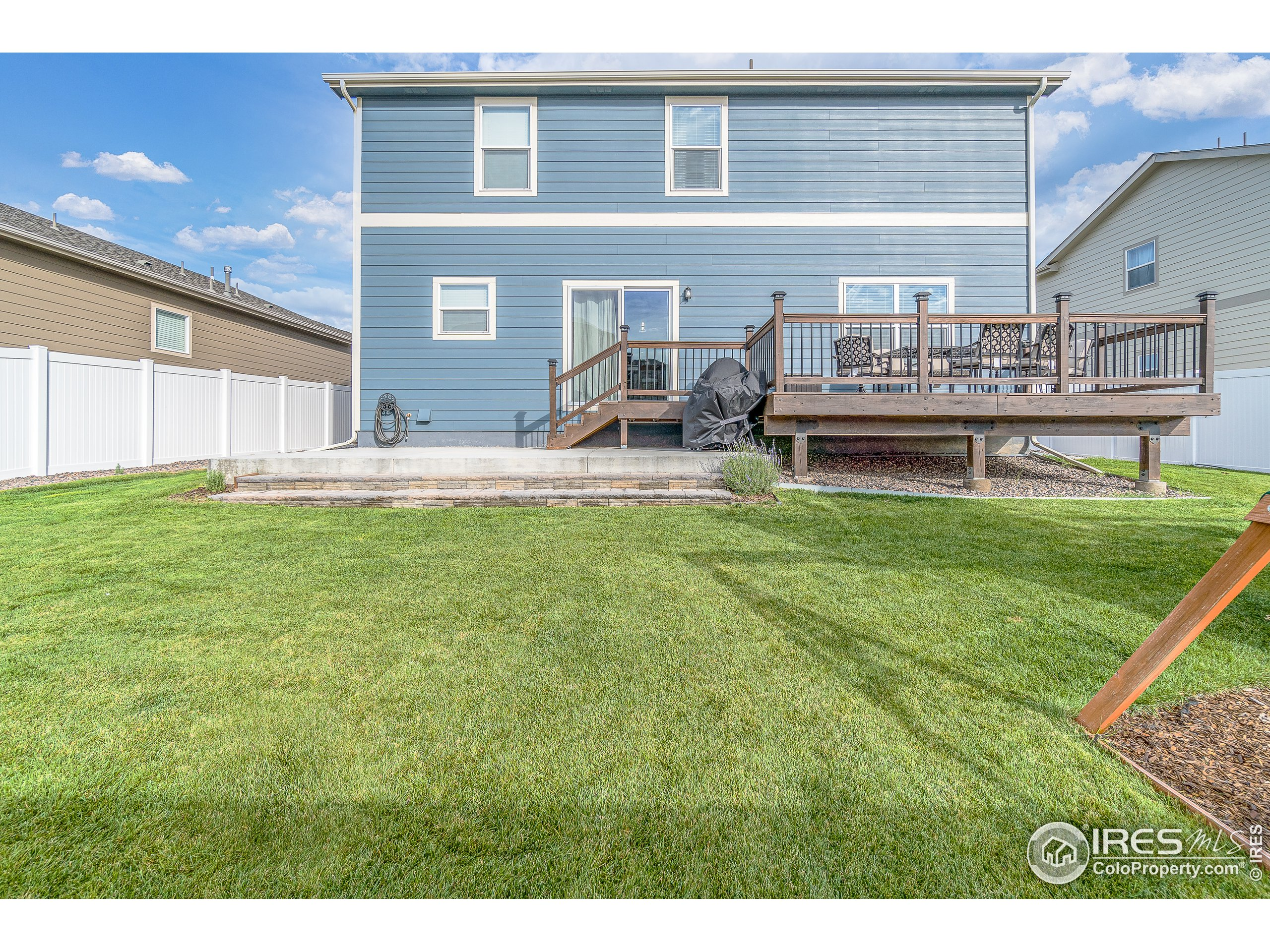 Large backyard with deck