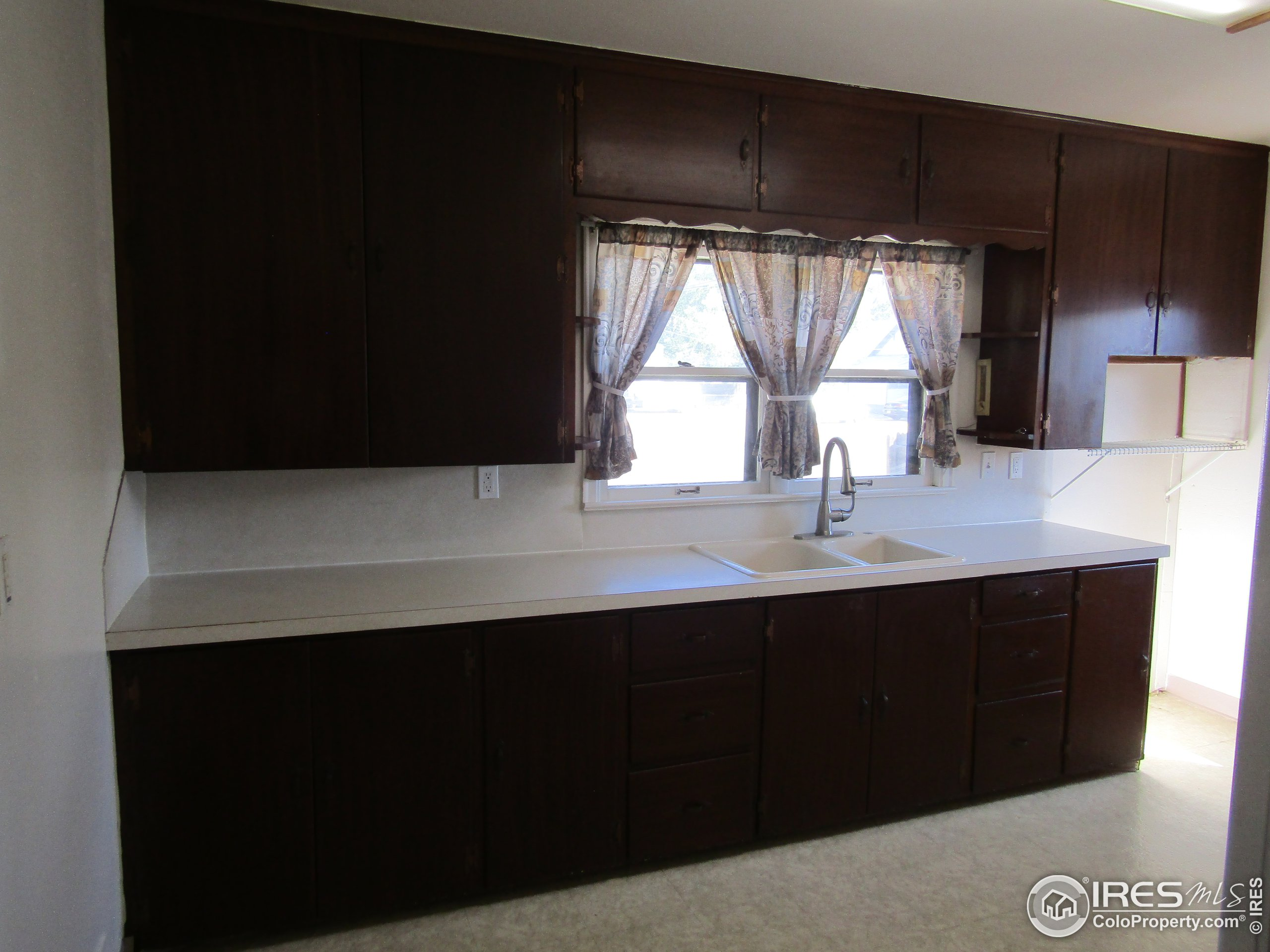 kitchen cabinetry/open space for freezer