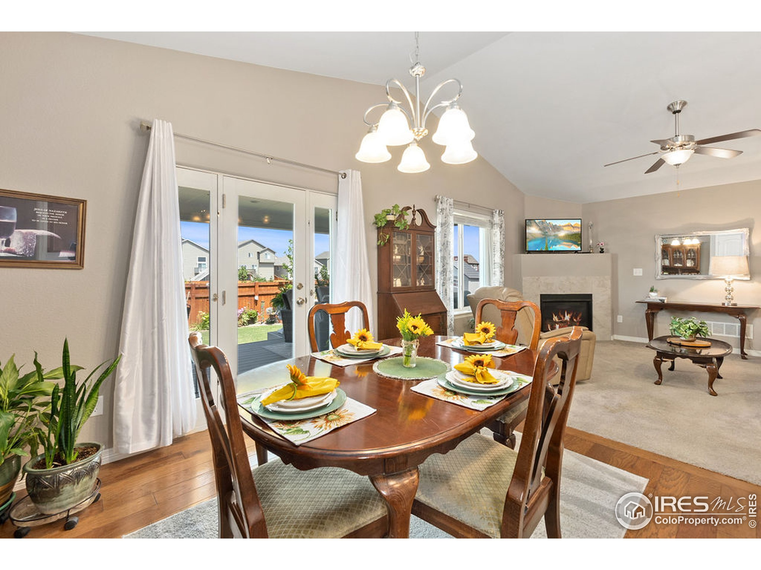 Dining area open to living room and has views and access to covered backyard deck