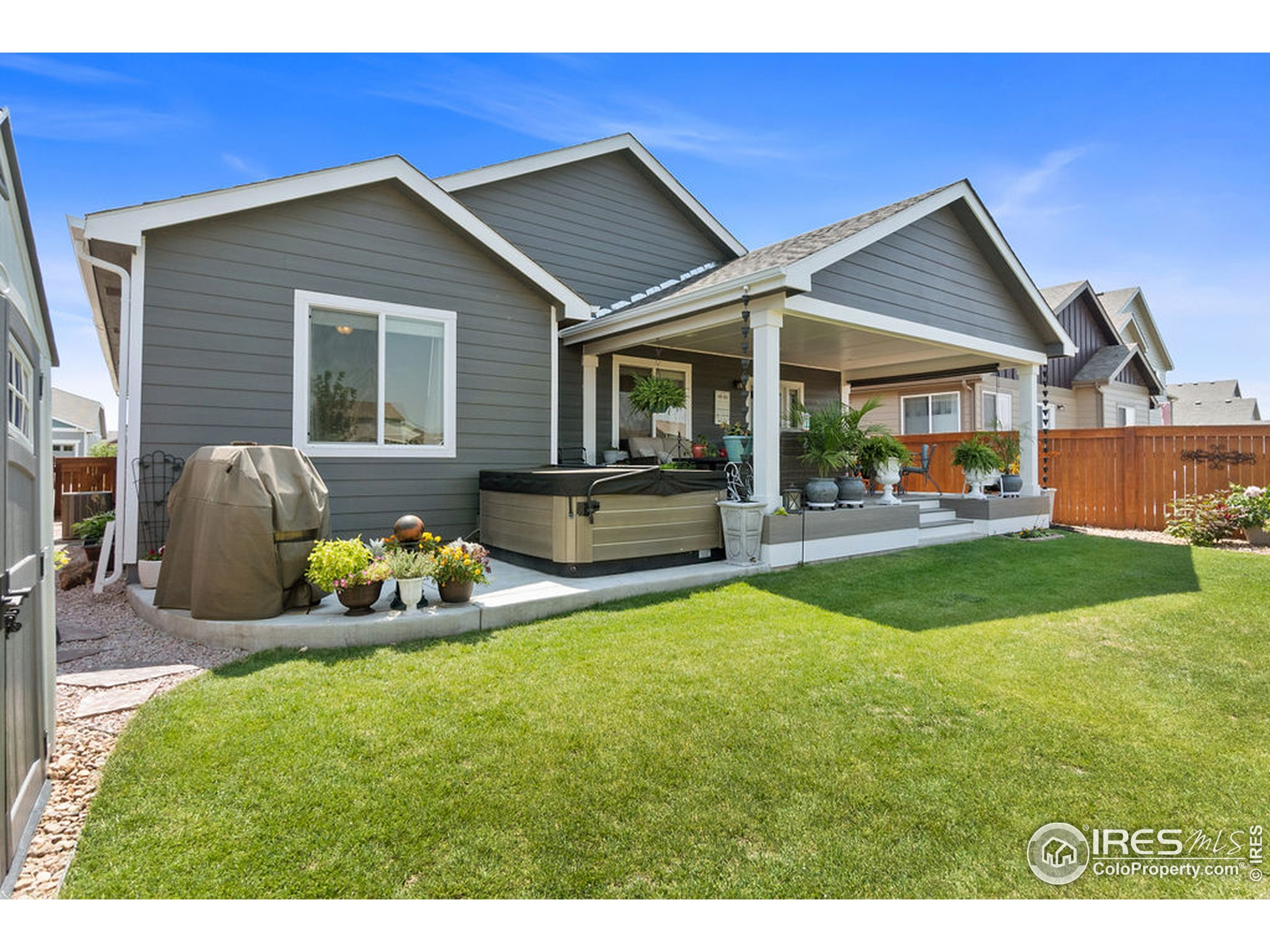 Gorgeous backyard and patio. Newer hot tub stays!