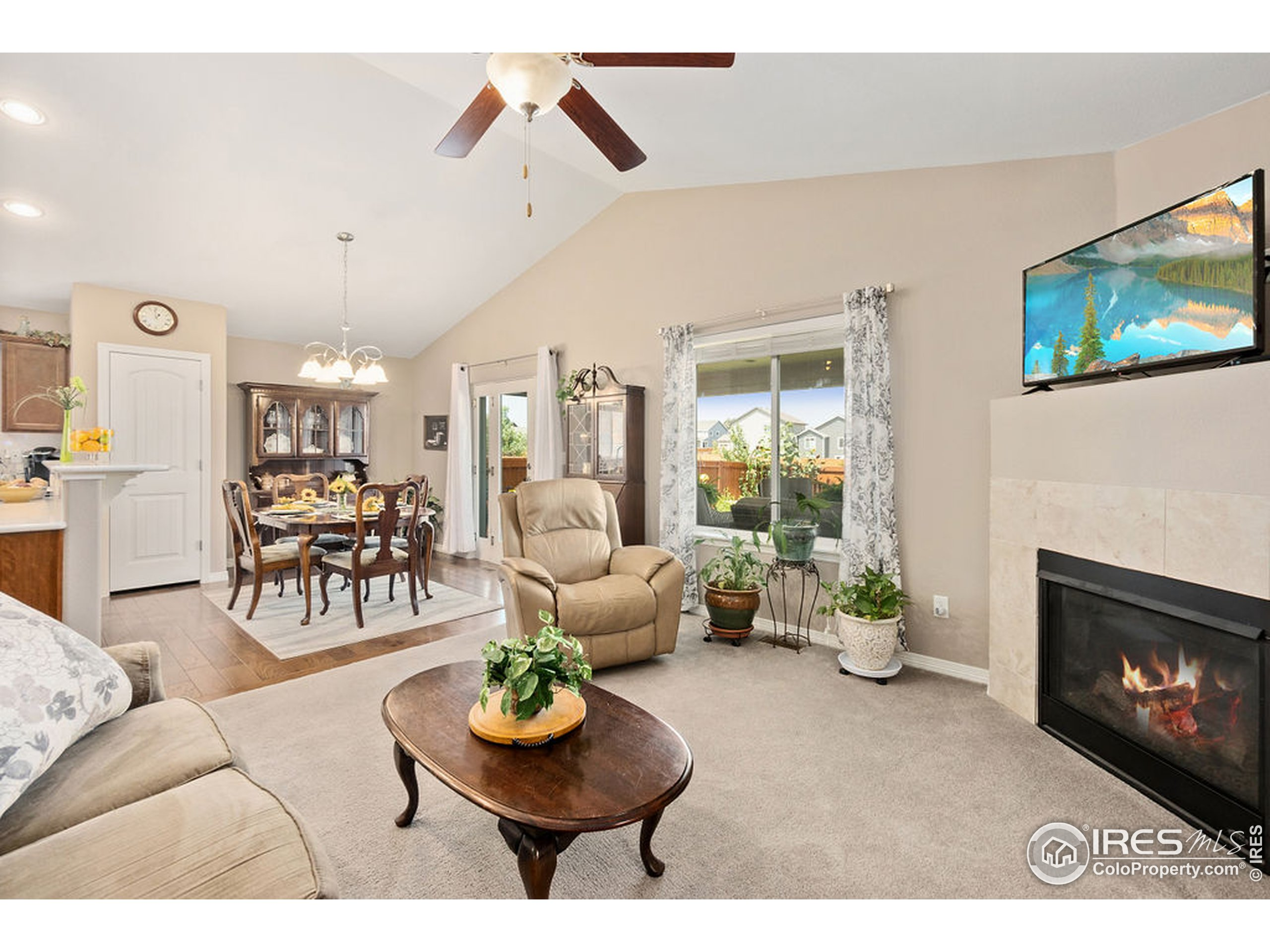 Corner gas fireplace with large vaulted ceiling