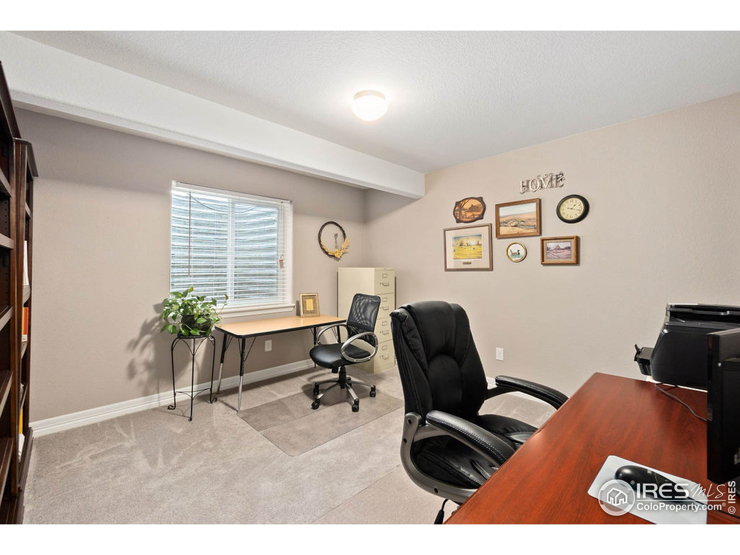 3rd bedroom with large closet used as office