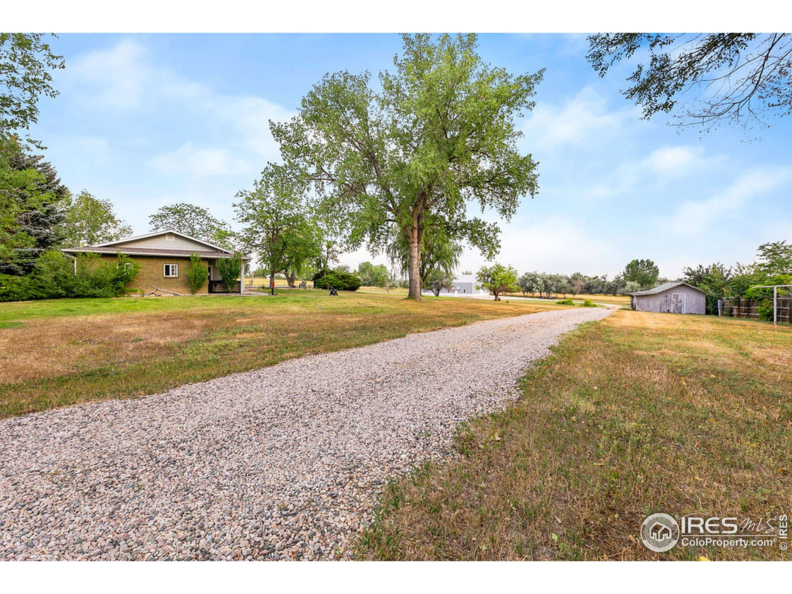Country Lane & well maintained road to shop