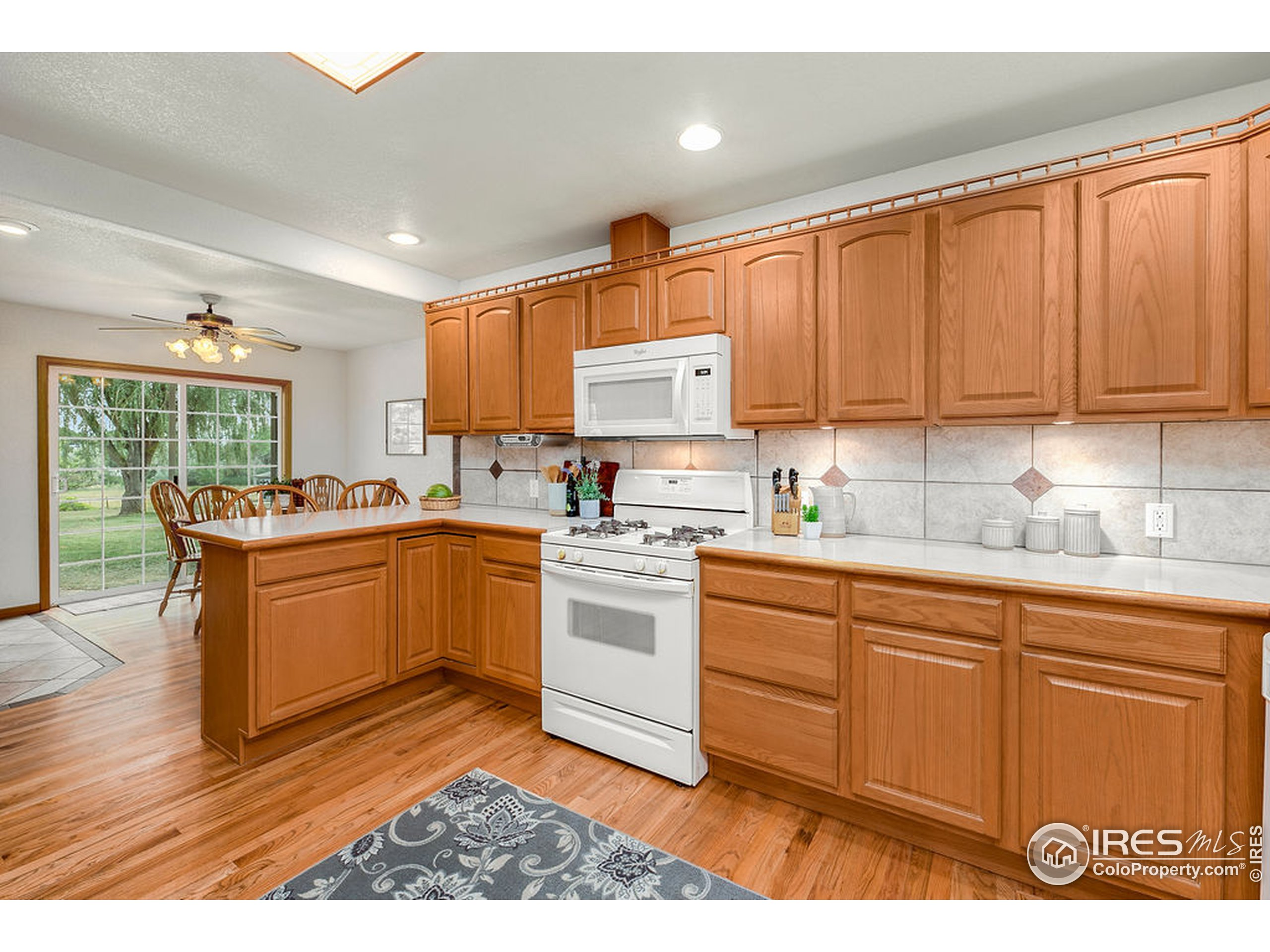 Wood Cabinetry & Full Height Kitchen Backsplash with Under Cabinet Lighting
