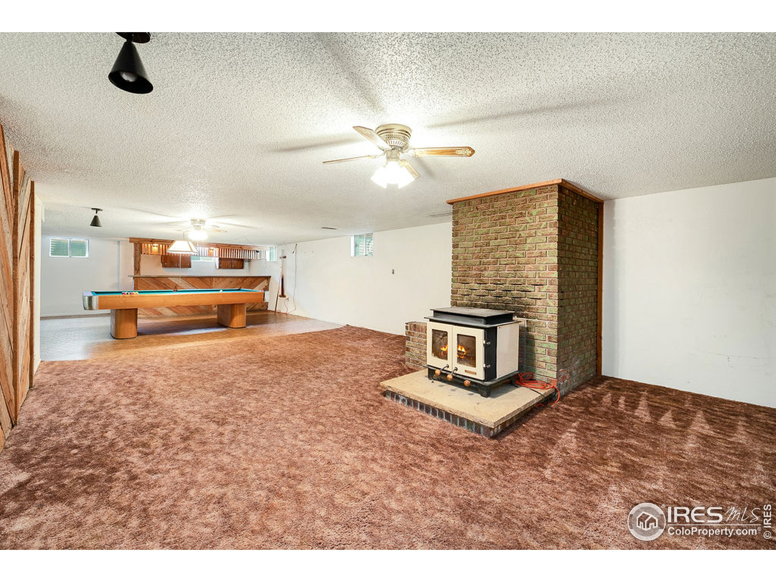 Open Basement Layout with Wood Stove