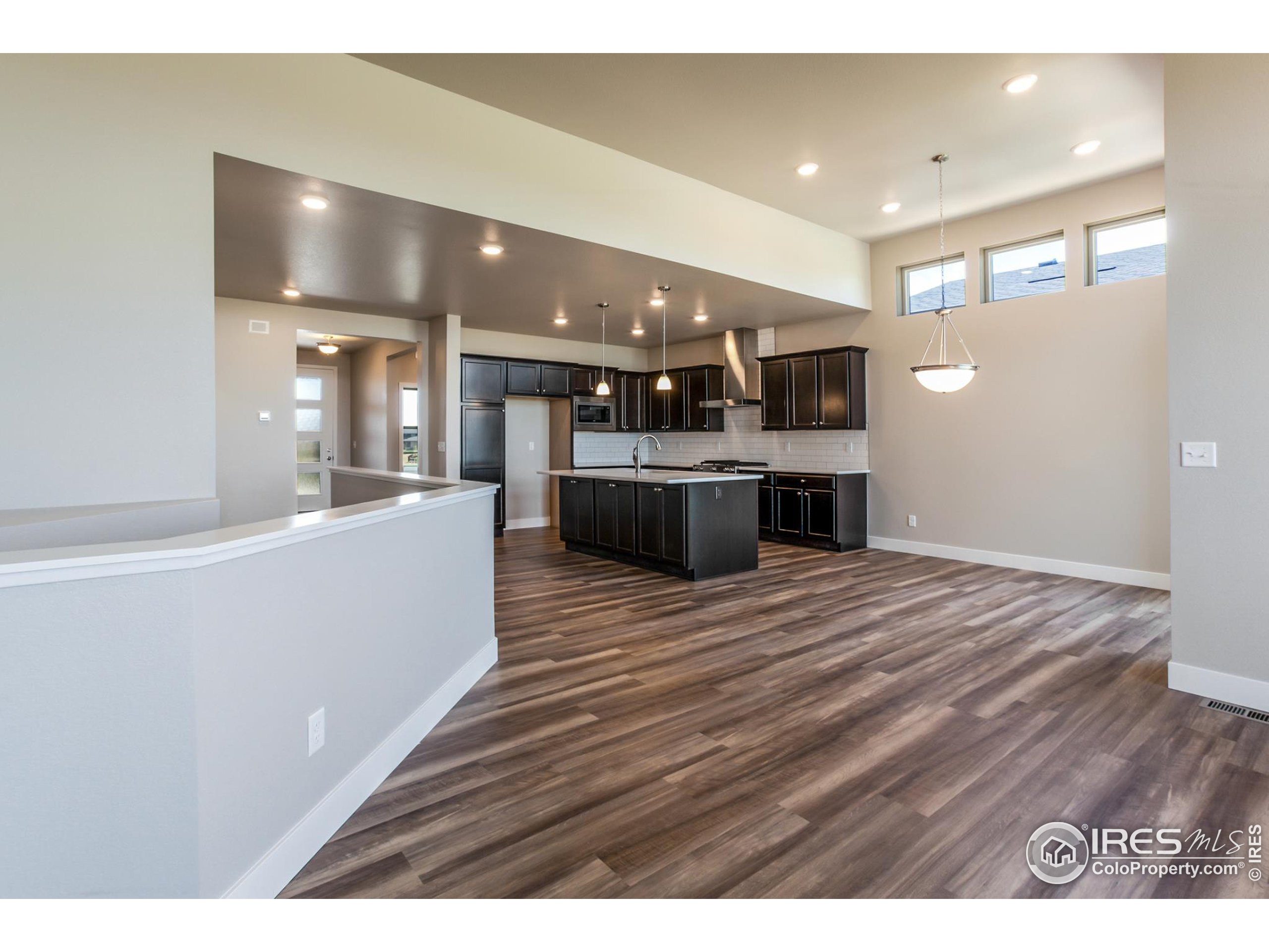 EXAMPLE PHOTO: KITCHEN ISLAND, OPEN TO DINING ROOM & GREAT ROOM