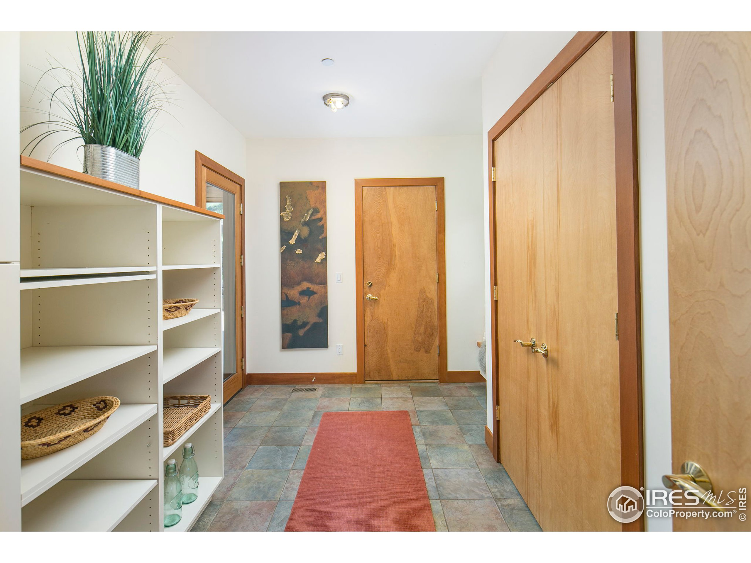 Mudroom with entry from garage or outside