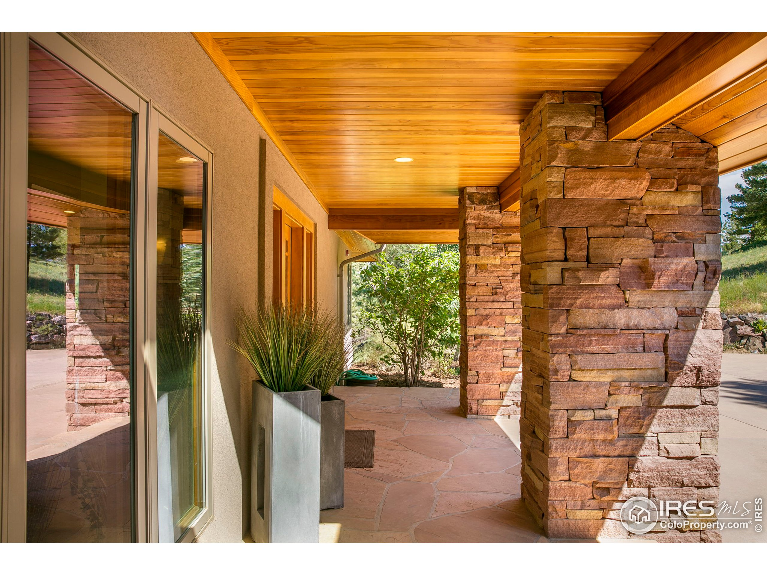 Covered front porch helps to protect against the elements!