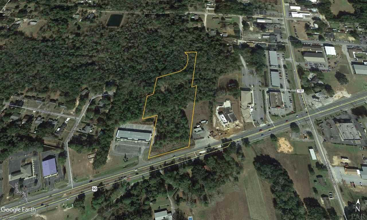 Rare larger parcel of land fronting Hwy 90. Over 280ft of road frontage and 5.3+/- acres. Zoned HCD Commercial for a ride range of commercial development use potentials such as: Automobiles and other vehicular service establishments, motels and hotels, business and professional offices, general retail and eating and drinking establishments, nursing homes, primarily characterize this district. The property is well suited for development being high and dry and level. The shape of the property maximizes the development potential with great location in the rear of the property for a holding pond and ample frontage for visibility and parking. Don't hesitate on this one, these sites are extremely scarce and almost non existent in this market.