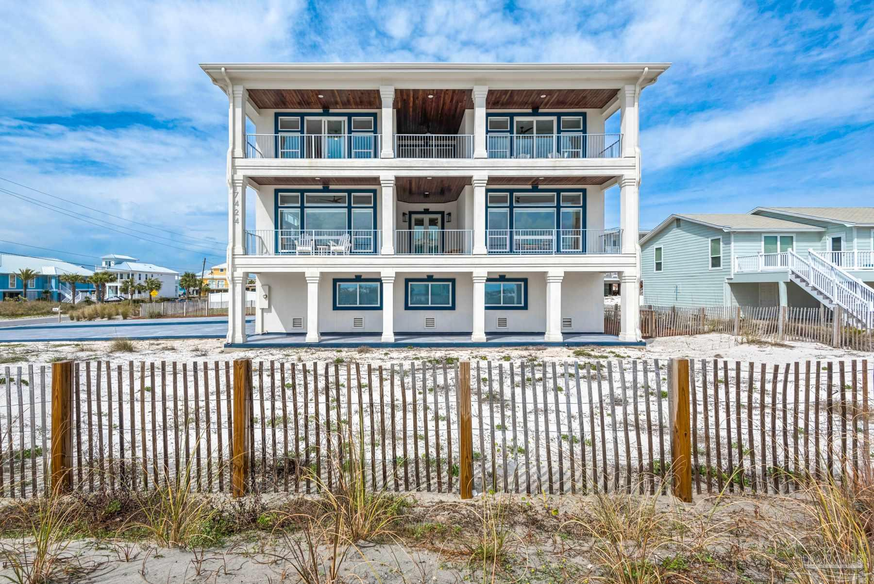 """This one of a kind luxury home is located on Navarre Beach on the beautiful white sands of Santa Rosa Island.  This up and coming location has been Florida's best kept secret, but word is getting out and plans are in the works that makes Navarre Beach the place to be! The grandeur of this newly renovated home boasts all the sophisticated luxury you are looking for.  With water views from every window, and an unobstructed South water view, you can watch dolphins play on the gulf side from the sitting room with extra large windows, or catch amazing sunsets from any of the covered or uncovered porches.  This home comes fully furnished and has been equipped with so many extras.  The incredible 24""""x24"""" Italian Marble floor on the main level, and this kitchen would make an executive chef envious.  With top of the line appliances, Natural Quartzite on the 9' island and countertops and the open floor plan, cooking in this kitchen is a pleasure.  With so much to see and admire, don't forget to look up at the marvelous custom made chandelier that is the star of the living area,  a wench was installed for ease of maintenance. There are two bedrooms that could serve as the master bedroom, one on each floor.  There is an additional 3rd bedroom with an en suite.  Some not so obvious extras are the porch's custom solid aluminum rails with automotive finish, whole house water purification system, air scrubbers attached to both AC units for air purification, three water heaters, whole house surge protectors, the list goes on and on.  All of this on a large lot with room for a pool, a quick and easy 100 yard walk to the pristine white sand beaches and just 500 yards to the award winning Gulf Island National Seashore. Call today to make your appointment to see this spectacular property! Be sure to click on the first Virtual Tour and """"walk through"""" this home with the convenience of the matter port virtual tour."""