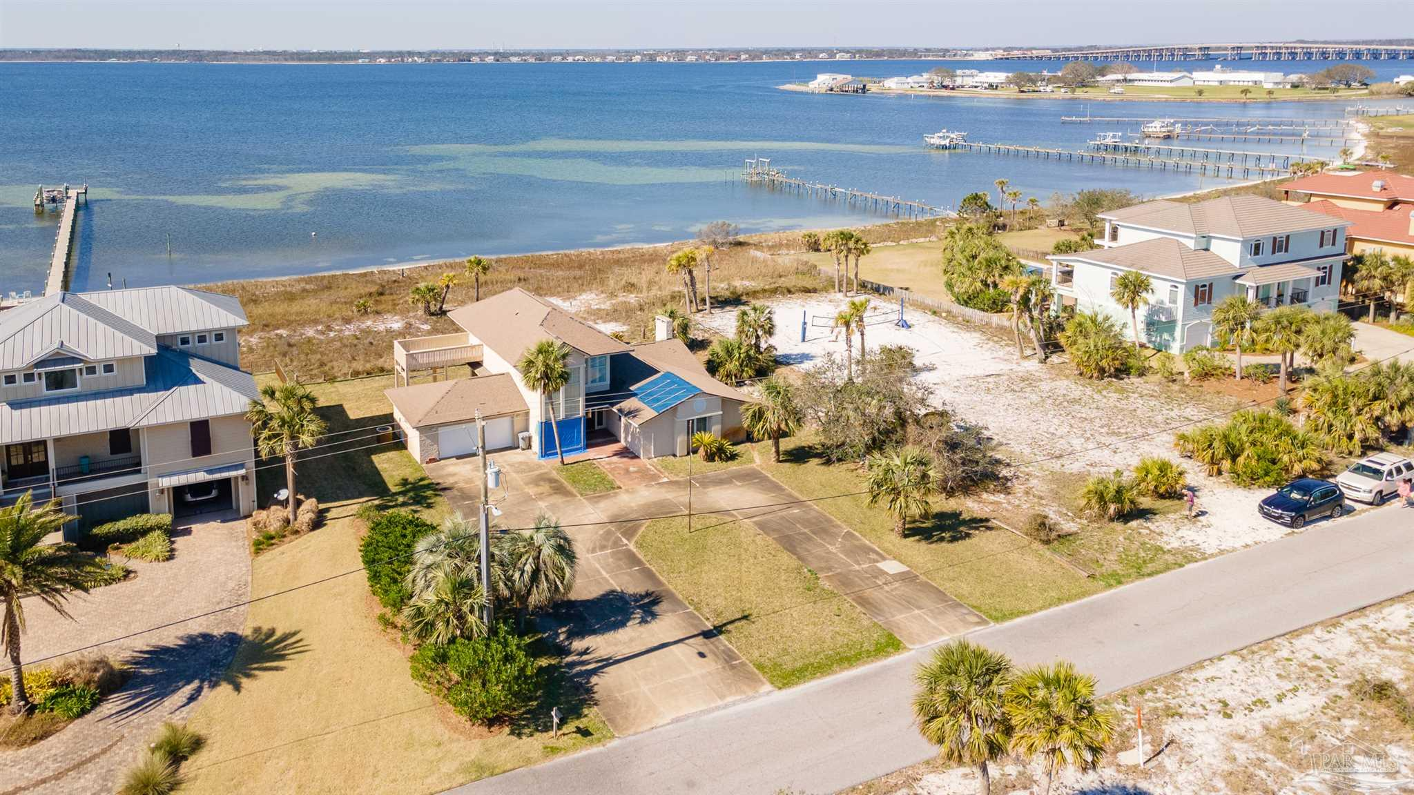 WATERFRONT on the Sound! Endless Sunsets from this more than a half acre Sound front lot!  Premier location on Sabine Drive.  Update this 4 bedroom home or build your own dream home.  You will never tire of the dolphins jumping in your backyard, bring your boat, your paddleboards, jet skis and kayaks.  This is beach living at it's best.  NO short term rentals.