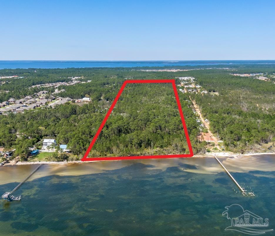 46 Acres on Santa Rosa Sound. Rare opportunity to own a large waterfront parcel with 450' of sound frontage and 450' of commercial property on Gulf Breeze Pkwy. 2.75 acres on Gulf Breeze Pkwy zoned HCD. Remaining 43 acres zoned single family residential. Development potential or private estate. Here's your chance to own an unspoiled, pristine waterfront property.