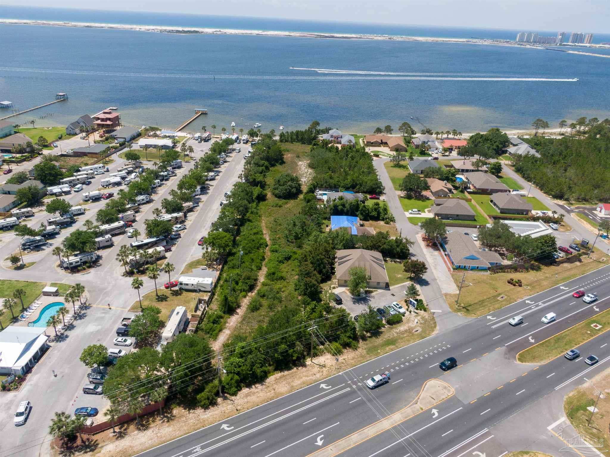 1.83 acres of Waterfront property in the rapidly growing community of Navarre. Located less than a mile East of the Navarre Beach Bridge, this property is perfect to build your dream home or to be developed for investment purposes. With 100' of frontage on the Santa Rosa sound, with its own beach, and direct access and frontage on Hwy 98, this property is a rare find! Property is across from the Hurlburt Specials Ops on the Gulf so there will not be any building there which means, you keep your view!