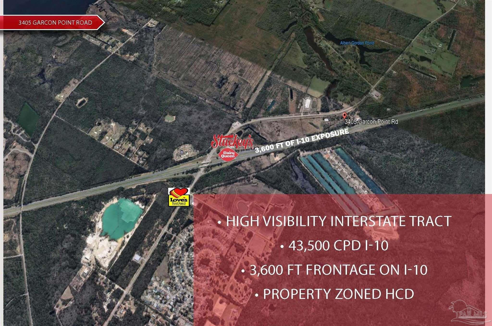 HCD ZONED ACREAGE on I-10.   This is a prime tract on Garcon Point Road and I-10. The property offers quick access to the City of Milton, FL, and Pensacola, FL with an incredible 3,600 FT of exposure along I-10.   The Northern boundary of the property adjoins Stuckeys at the Garcon Point Road / Baghdad Exit. A 12,000 SF Loves Travel Stop is under construction on the Northeast quadrant of this exit (opening Summer 2021)  The property is highly suitable for a Mixed Use Commercial Center, Hospitality, RV Park, and Industrial User.  The owner will consider subdividing.   The property contains two metal industrial buildings. One is 15,000 SF+/- with 20 foot +/- eave height, and a 12 +/- foot wide by 18 +/- foot high swinging door. The other building has 9,600 SF +/- with 15 +/- foot eave height,18 +/- foot wide swinging door by 12+/- feet high. Both buildings structures and roofs are in good shape.