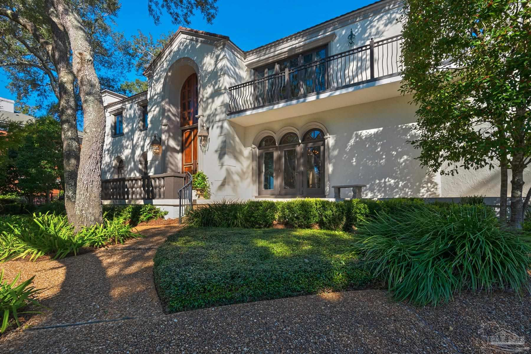 Location, location, location, view, view, view! This waterfront home has it all. It is nestled in a secluded cul de sac amongst gorgeous old oaks and across the street from a never to be developed green space.  On the magnificent water side, there is an unobstructed panoramic view of almost 180 degrees stretching from the Pensacola Bay Bridge to the Garcon Point Bridge. Step inside through the massive custom entry doors with views of the bay in every direction.  The entry is highlighted by a floating staircase featuring custom iron railing by Brownsville Ironworks .  To the left is the formal living room with its wall of French Doors and to the right is the formal dining room with a matching wall of French doors. The kitchen looks out to the bay, and the freeform Gunite pool and covered patio.The great room and bar area are surrounded by more French doors, and large windows.  Your view is everywhere. There are 2 very large bedrooms are on the first floor and each has its own full bath.Upstairs is the master suite featuring granite countertops, a large jetted tub, an oversized walk-in marble shower and a water closet.  The walk-in closets have all been customized and well appointed.The fourth bedroom also has its own full bath.The home is located close to shopping, A+rated schools and a short distance to Pensacola.Additional features include a whole house generator, 3 a/c units(all new in the past 5 years),and an oversized garage.Last but not least is the seawall and walkway with special railings that span the waterfront.