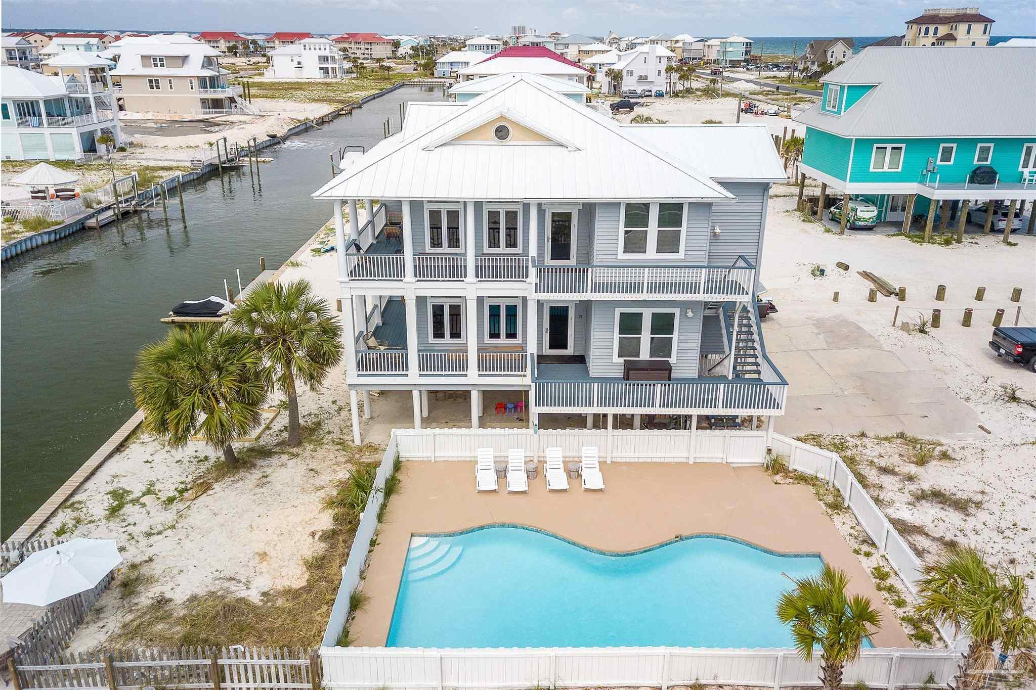 LOCATION LOCATION LOCATION . Waterfront with 90 Feet of canal. Wonderfully remodeled and interior Designed to a high standard. No HOA, This location is stunning , Boasting a New seawall , & Recently dredged canal . Breathtaking views and steps to the public Beach access. The beach house has its own private in ground pool , Recently re Plastered with warranty . Great rental potential. Rental Projections of $150k - $160k per year. This is a outstanding property that boasts it all. Huge updated kitchen / stainless appliances and stunning wrap around decks / Cathedral Ceilings/ Impact Windows. The list goes on and on. More photos and virtual tour to follow soon