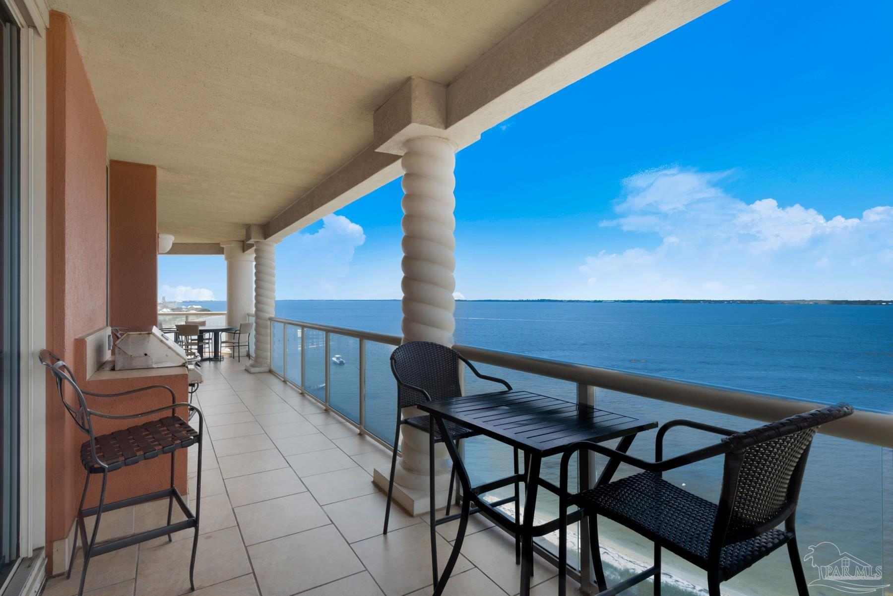This three bedroom Portofino unit offers spectacular unobstructed views over Santa Rosa Sound. Enjoy the unobstructed Western views looking down the coastline. Tower 4 is located right by The Lifestyle Center. This unit comes with a beautiful custom made wet bar for entertaining that has new ice maker.  Upgrades include tile throughout, granite in kitchen and bathrooms, crown molding throughout, knock down ceiling finish, new beds in master and guest rooms, and outdoor cooking center. The lifestyle center includes The Terracotta restaurant, Terrazzo Bar and outdoor grill, two pools with hot tubs, an Olympic size indoor heated lap pool, spa and a fitness center overlooking Santa Rosa Sound with True and Cybex equipment. The property adjoins National Seashore to the east with miles of sugar white sand beaches and emerald green water. Our narrow island location and unique triangular shaped towers offers a water view from every room. Turn key ready!