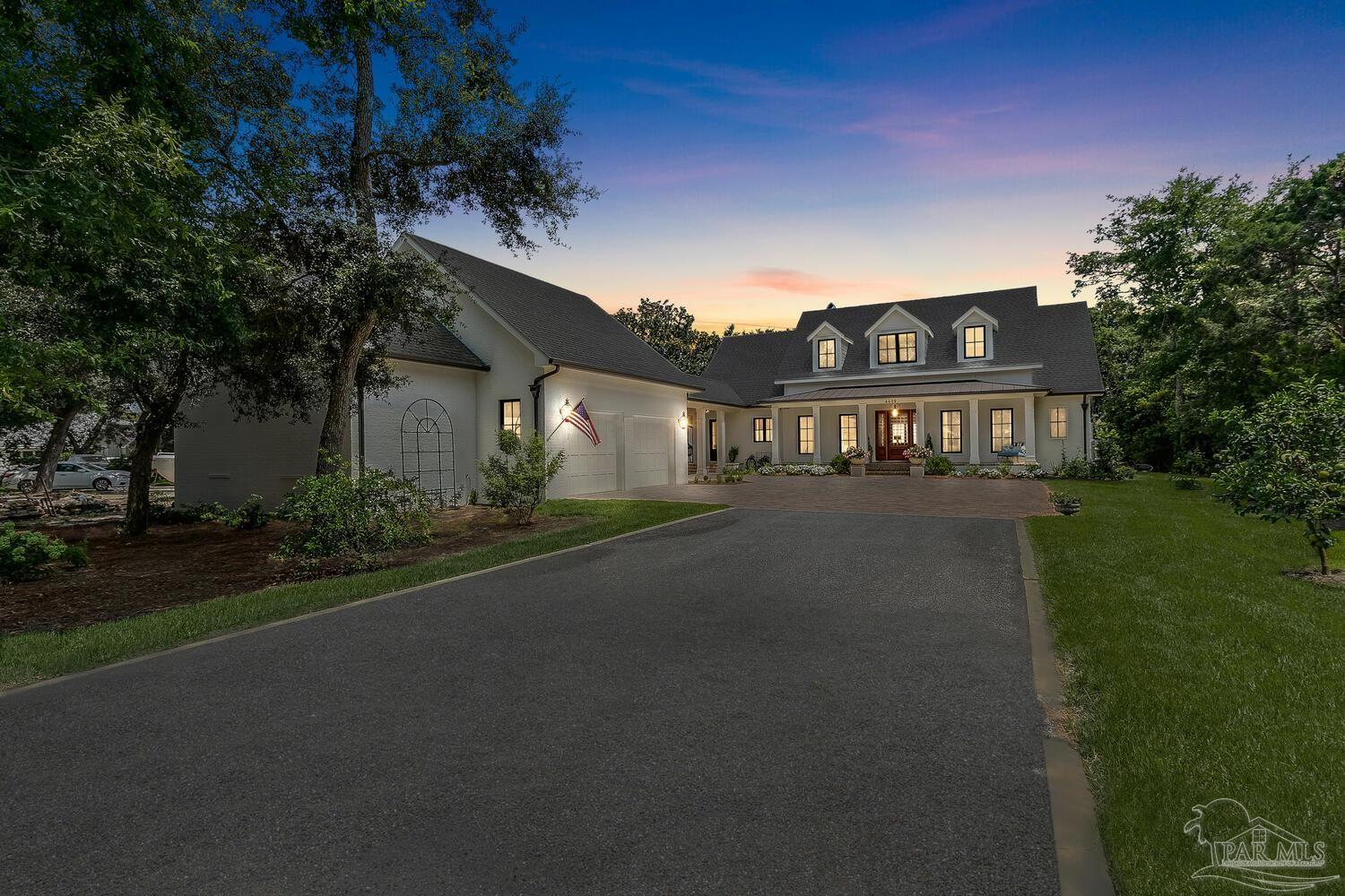 Coastal Living meets Southern Living in this fabulous waterfront retreat! Constructed in 2020 of the finest materials and finishes, this residence is stunning! Open the door to sweeping views of the Santa Rosa Sound that welcome you home. The flawless design provides a bright and airy coastal ambiance with remarkable architectural details and craftsmanship. The first floor is designed for entertaining with open concept living spaces that open to the outdoors. The boat dock with lift is where the outdoor festivities begin with boating, fishing, or kayaking. The dock offers a lift to accommodate a large boat. After your outdoor activities, retreat to the 400 sq ft porch complete with brick pavers and a brick wood burning fireplace as the gathering area. The doors and windows are all impact glass. The millwork throughout the home is top of the line. The kitchen highlights two built-in pantries with a pop of color and antiqued mirrored glass insets. There is an expansive island, two sinks, six burner gas cooktop, pot filler, a custom hood and stylish champagne gold hardware. There is a great homeschooling/office space that adjoins the kitchen. Then continue onto a spacious laundry/mudroom. The downstairs hosts the master suite as well as one guest suite. As you would expect, the master offers beautiful water views, a fabulous bath and oversized closet with custom built-ins. Upstairs, two guest bedrooms open to a large playroom/den. This area boasts panoramic water views There is walk-in storage that can be converted to additional living space. Adjoining the oversized garage is a heated/cooled fishing room.  Above the garage is more space with electrical/plumbing that could be finished out for a guest apartment. The home is located on .75 acres, affording privacy and plenty of space for a pool or guest house. One of the most beautiful homes on the Gulf Coast, this waterfront retreat is a dream come true!
