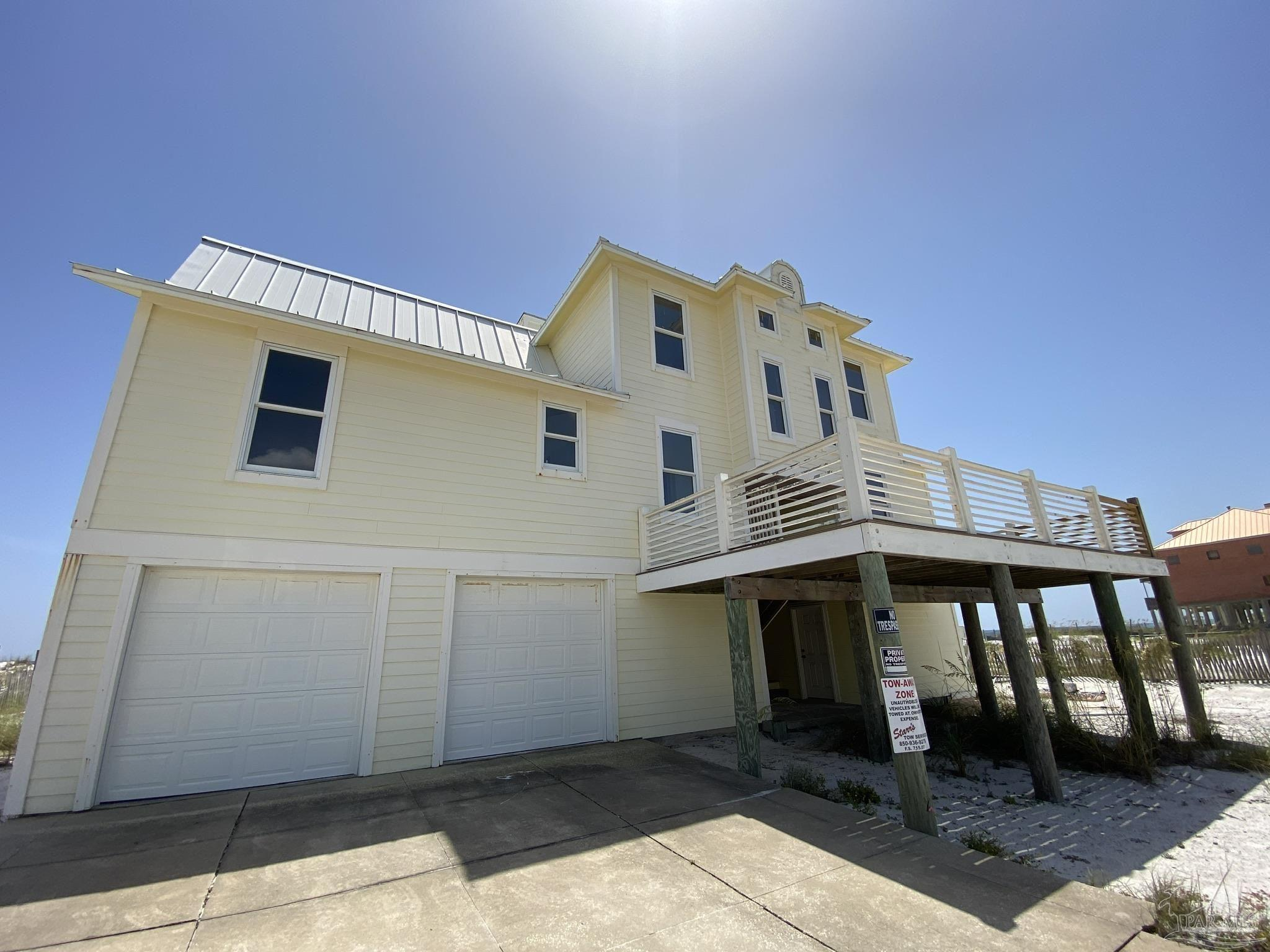 **LOCATION**LOCATION**LOCATION**  Here is your opportunity to own your GULF FRONT primary residence, 2nd Home or Vacation Rental Property.  Only 5 lots from the west end of Navarre Beach this location is one of the very BEST ON THE BEACH!!  With 4 Bedrooms, 3.5 Bathrooms with the most amazing views from every room.  Large decks on both living levels plus covered space on the ground level make this property GREAT FOR FAMILY GATHERINGS, CORPORATE EVENTS OR PARTY / WEDDING VENUE.   Interior is ready for your finishing touches.  Appliances were purchased new and still remain in their boxes.  All items including appliances and renovation materials will convey with the home.