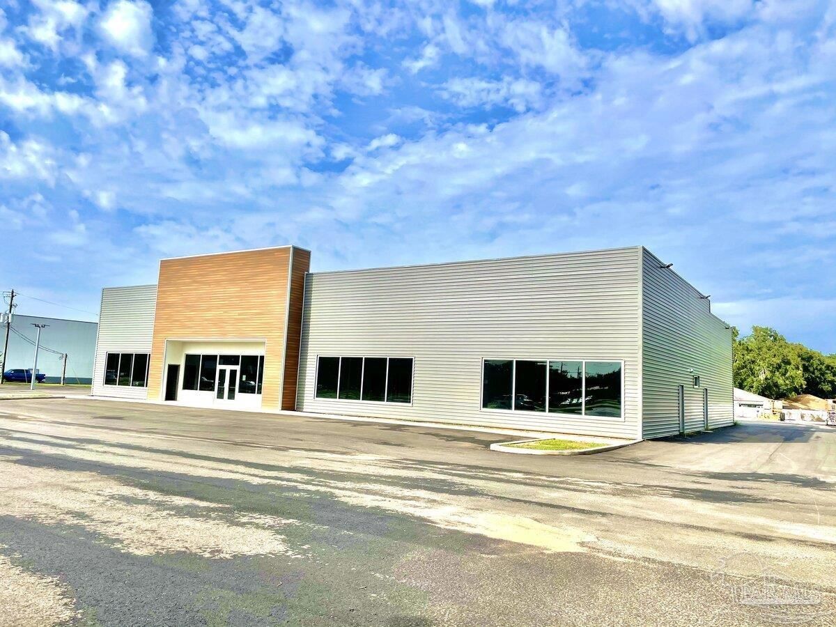 The Whibbs Group is Proud to Offer Powerful Retail/Digital Sales Potential in this Brand New state of the art free standing building built in 2021. Enjoy great visibility in a high traffic, super hot location at W St and Airport Boulevard intersection exploding with growth.  Highest and Best use would be Automotive Retail/ Internet Retail Delivery Center, as it lies less than 1/4 mile south of Manheim Auto Auction and a block west of several of the largest players in the new car franchise arena.  Other possible uses, including medical office space, ambulatory surgical center or any type of commercial retail, are in play. Awaiting landscaping for issuance of final certificate of occupancy, building is turn key and ready for immediate occupancy at closing. This very well thought out high end facility sits on giant 2 +- acre graded and paved asphalt parking lot engineered with all drainage infrastructure and lighting.. None of the site was dedicated to storm water retention as it is piped into adjacent lot preserving full use of parking lot. With enough Black Gold to park 150 Units and Retail Planning Potential of 100 plus retail units a month. 5 full service bays allow additional Recon Profit Center Potential. New in the Box, Ready to Go!
