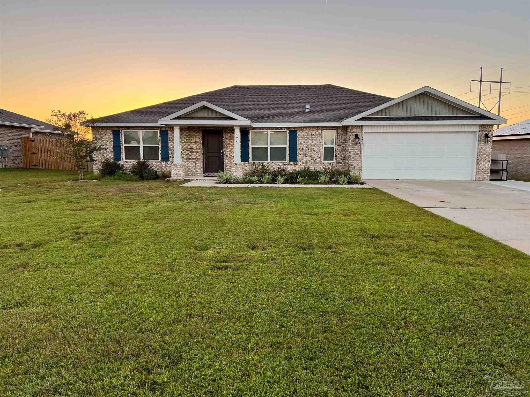 Welcome to Whisper Creek in Milton Florida. This home is ideal for anyone looking for new construction but doesn't have the time to wait for a new home to be built. This 4 bed | 2 bath home features over 2000 sqft of living space and construction was completed in November of 2019. Inside this open concept home you'll enjoy laminate wood floors and plush carpet in the bedrooms. This home also features vaulted ceilings in the main living area; making this home feel even more spacious. This area has beautiful sunsets that you can gaze upon from the covered back porch and relax on your quarter acre of heaven. During ownership the seller has extended the concrete on the front porch and extended the driveway. Enjoy community features such as underground utilities, good schools,  shopping, and a quick drive to Whiting Field.