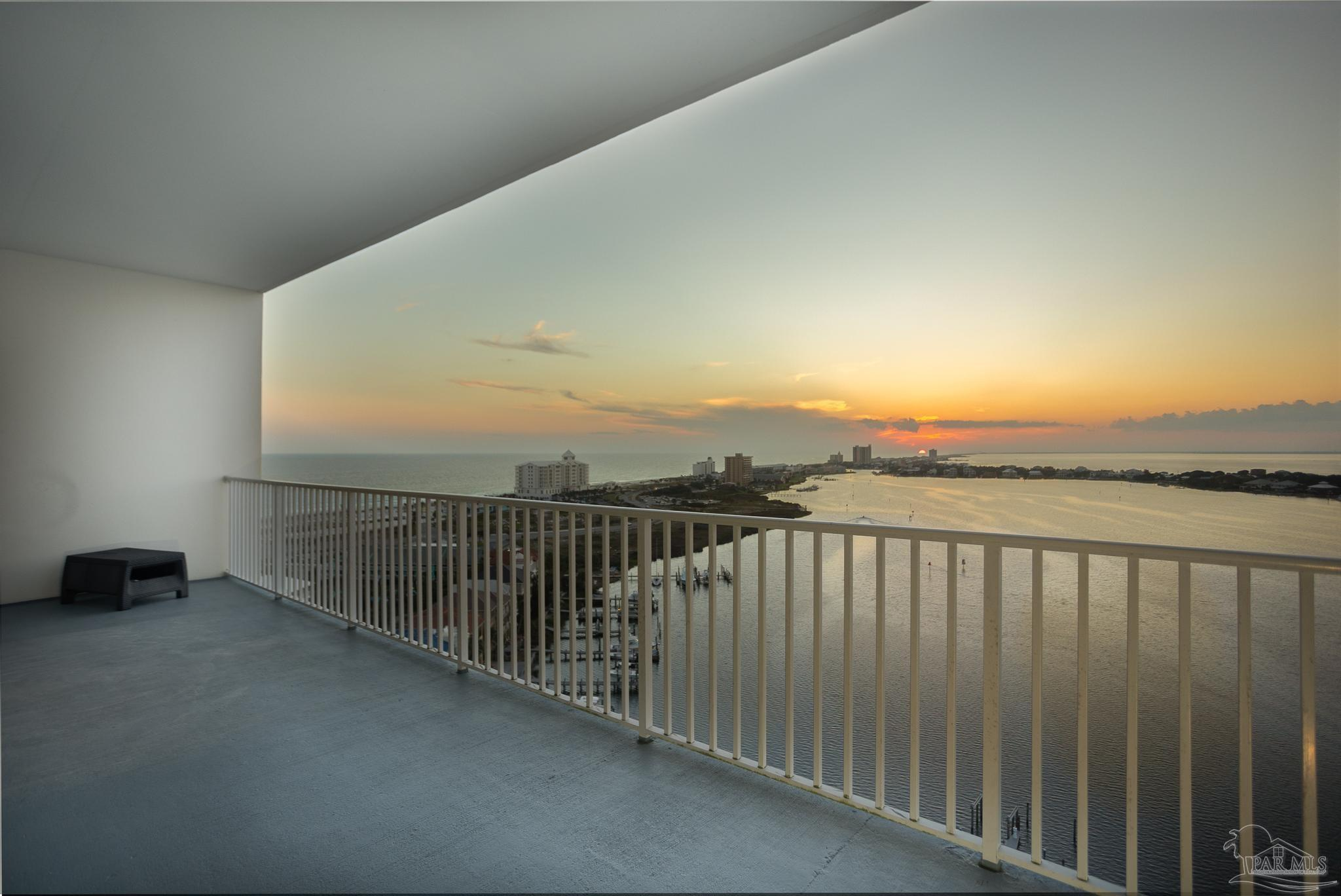 Welcome to penthouse living à la South Harbour. This home boasts views from every room and every window of the Gulf, the Intercoastal and Little Sabine Bay. A home built for entertaining, the balcony can hold 30 - 50 of your closest friends, and be prepared for them all to swoon when they catch a glimpse of the sunset from here. This 3/3 does not leave you wanting for the interior, either. The kitchen boasts new quartz countertops that overlook the dining area and spacious living room. French doors connect these spaces to the bonus room, and each of these wall-to-wall windows and sliding doors are tinted for your convenience and comfort. Sliding doors give entry to the balcony from the living room, bonus room, and master bedroom. The master is generously sized to accommodate your king sized bedroom ensemble and still allows you to easily move around. A hallway connects the master bedroom and bathroom, tying this suite together with his-and-hers closets and a fully mirrored dressing area between them, a door at each end lets you easily close off from the rest of the home. The master bath also boasts new quartz countertops, a deep jetted soaking tub, and a separate walk-in shower. This end of the home also features a 2nd bedroom with its own dedicated bathroom. You guessed it, quartz countertops! Passing back through the entry to the opposite end of the home, you will find the 3rd bedroom, extra storage space, and a common full bathroom. Travertine tile lies throughout the entire unit, with crushed seashell inlay to bring the aire of beach inside. Really, though, all you need to see is the sunset.